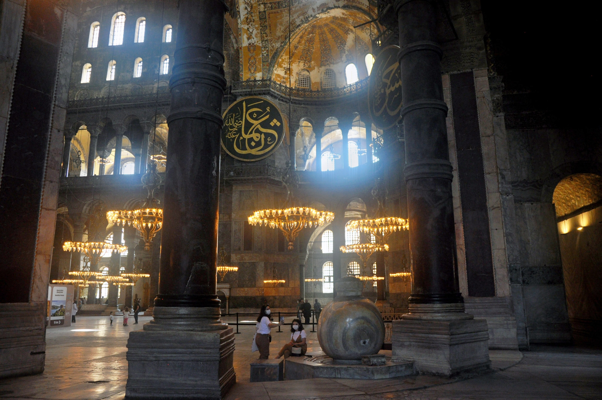 Tourists take in the ornate beauty of the Haghia Sophia dome