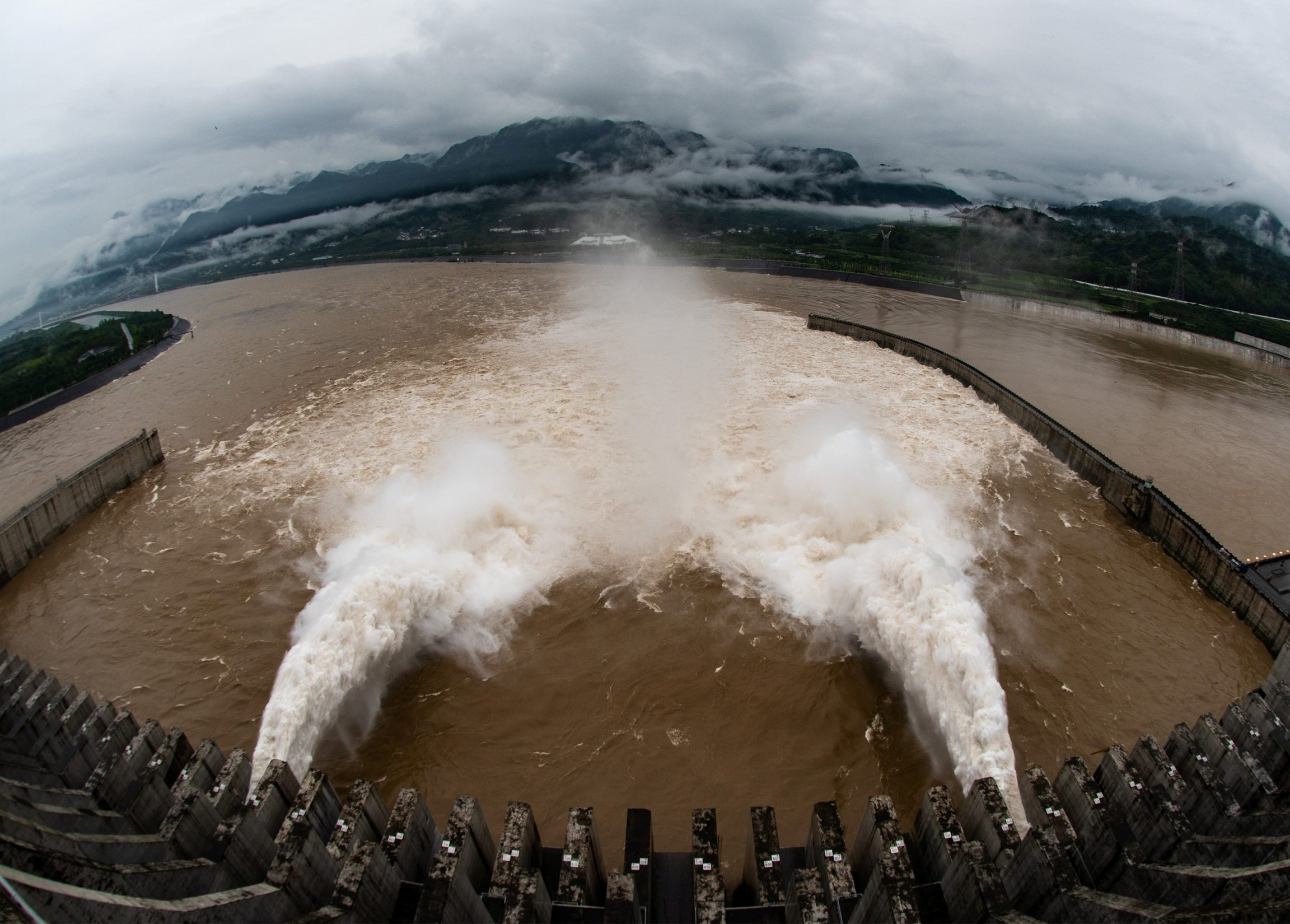 A gush of water discharges to lower water levels from the Three Gorges Dam