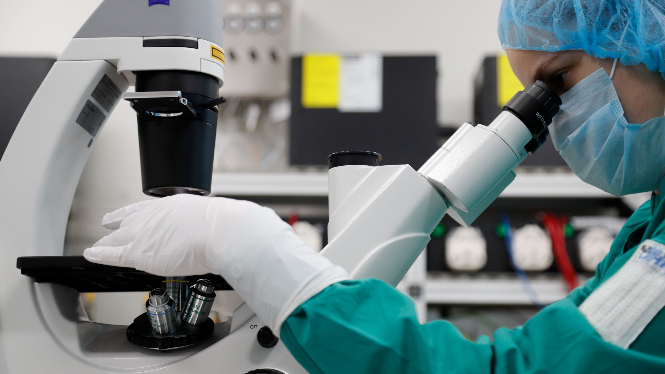 A scientist examines COVID-19 infected cellsunderamicroscopeduring research for a vaccine against thecoronavirusdisease (COVID-19) at a laboratory of BIOCAD biotechnology company in Saint Petersburg, Russia, May 20, 2020.