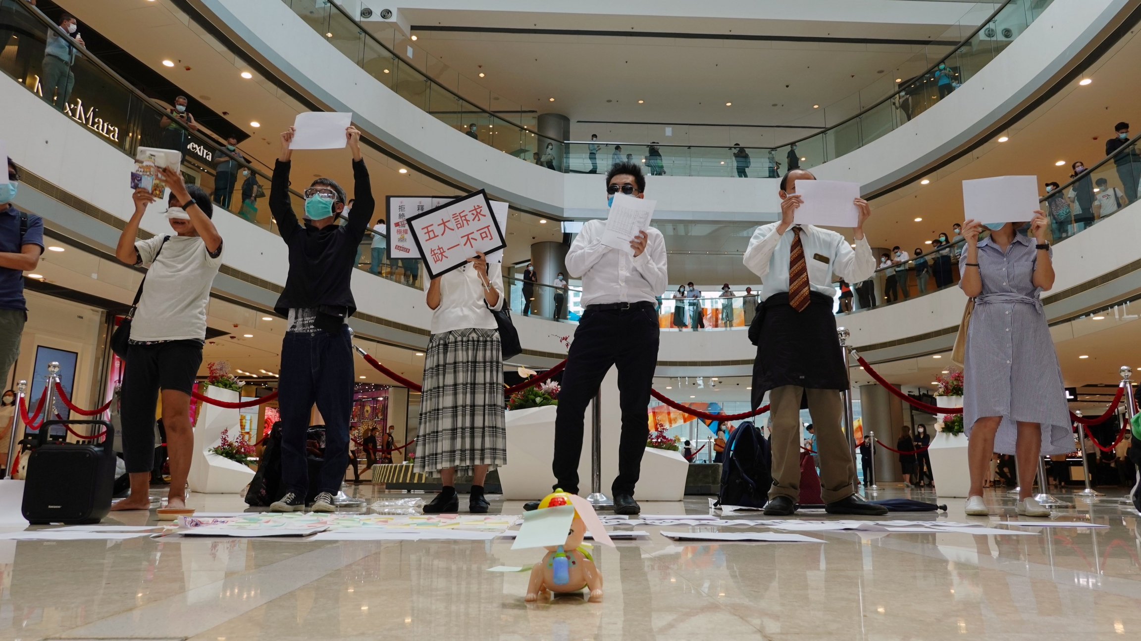 Pro-democracy demonstrators take part in a lunchtime protest against the national security law, at a shopping mall inHongKong, July 6, 2020.