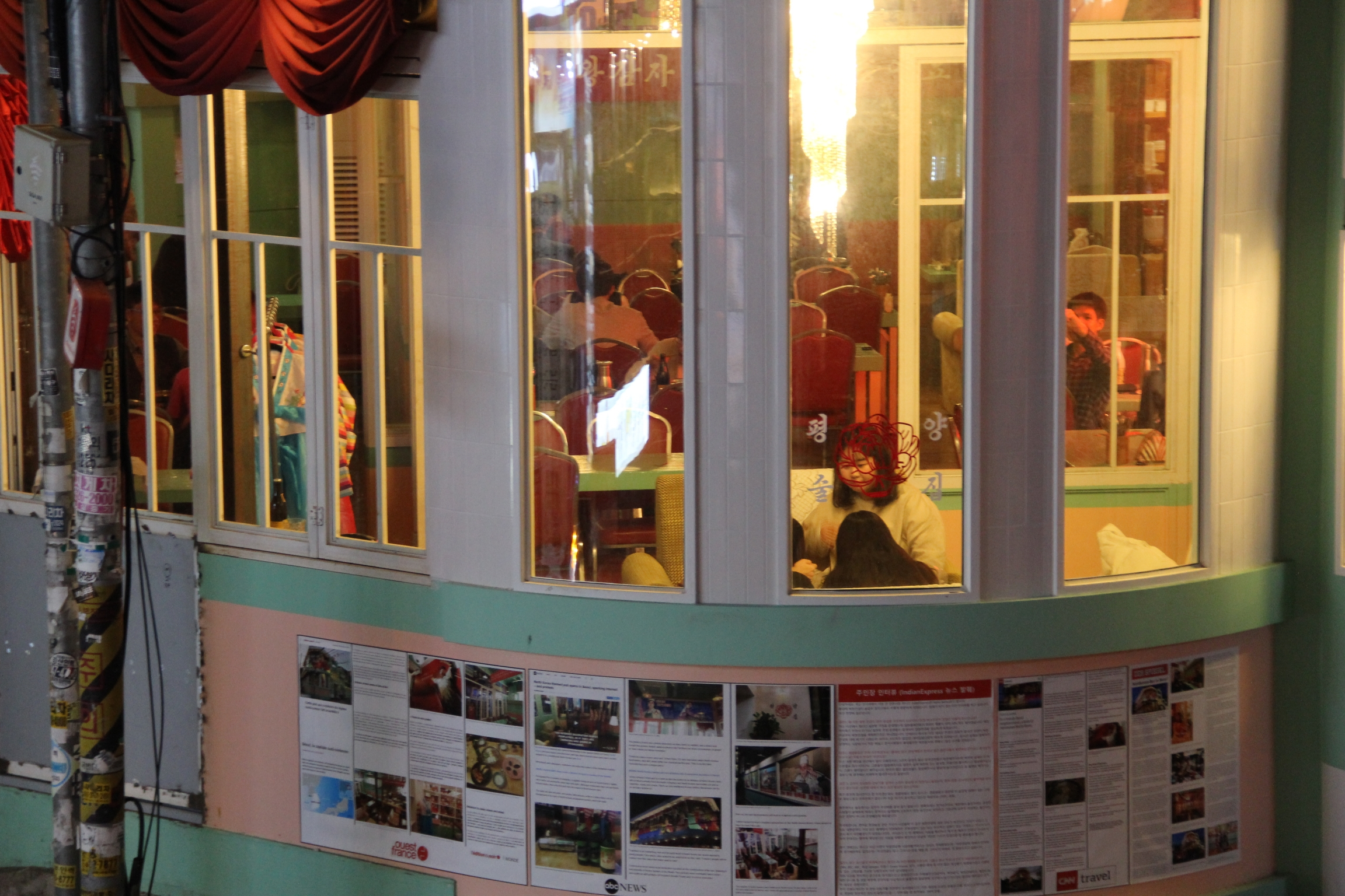 Articles about the pub published by foreign media outlets are taped on the mint walls outside which are reminiscent of North Korea's pastel-colored buildings.