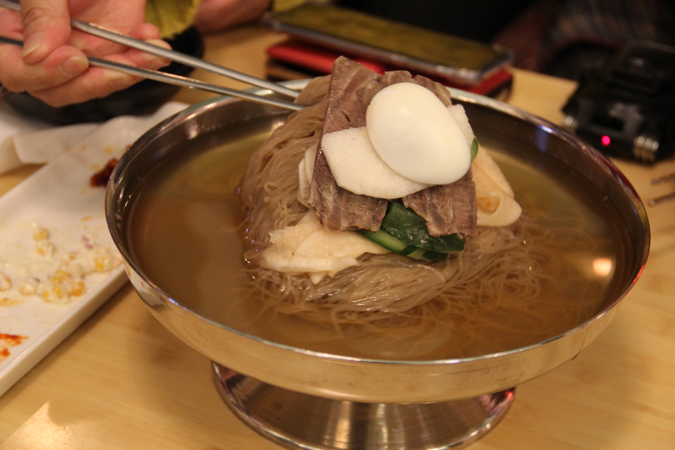 Kim Eun-joo was surprised that the mool naengmyun (cold noodles) were served in a wide-rimmed brass goblet, just like in North Korea.