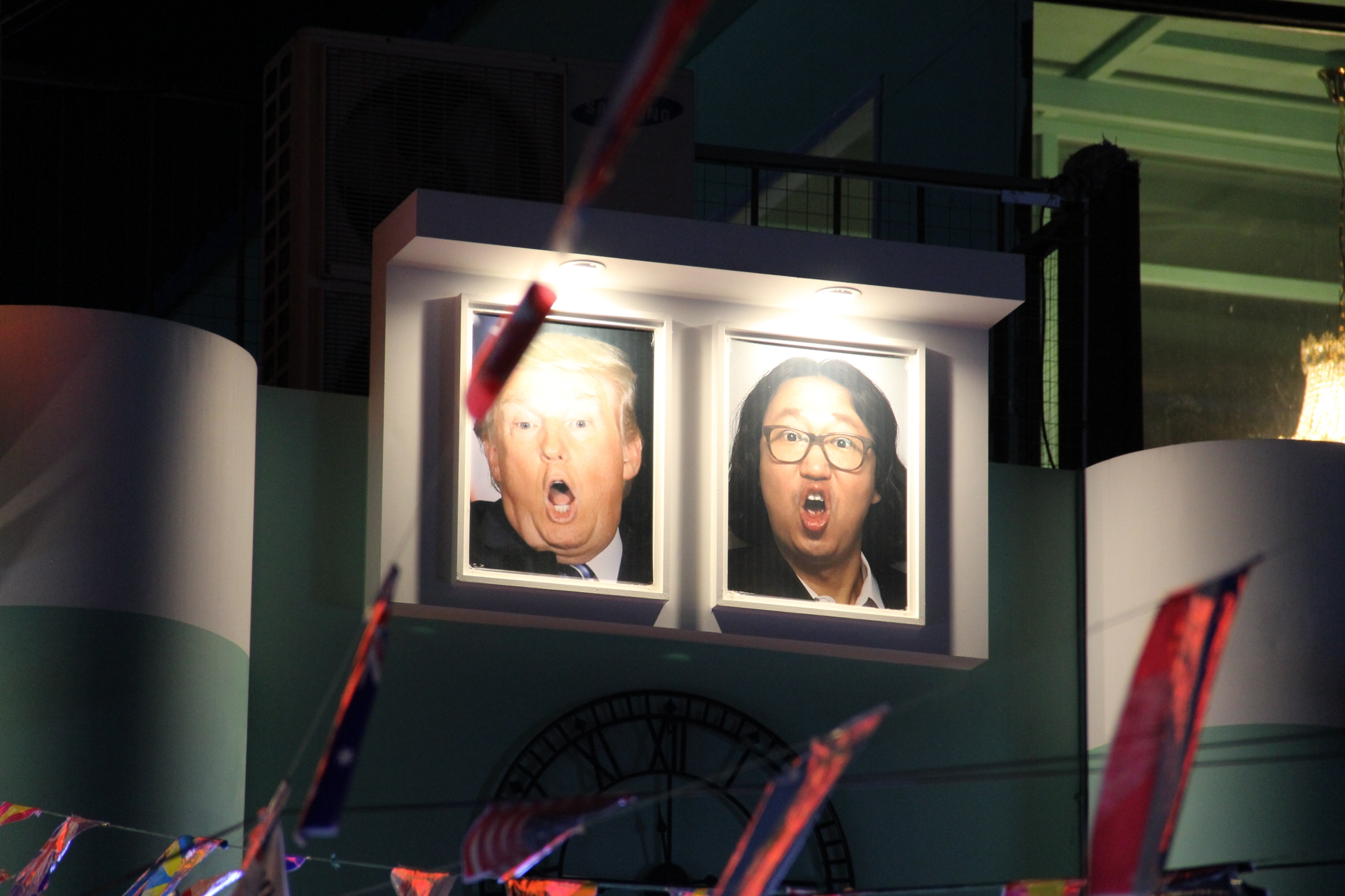 Caricaturelike portraits of United States President Donald Trump and South Korean comedian Kim Gyeong-jin are displayed outside the pub.