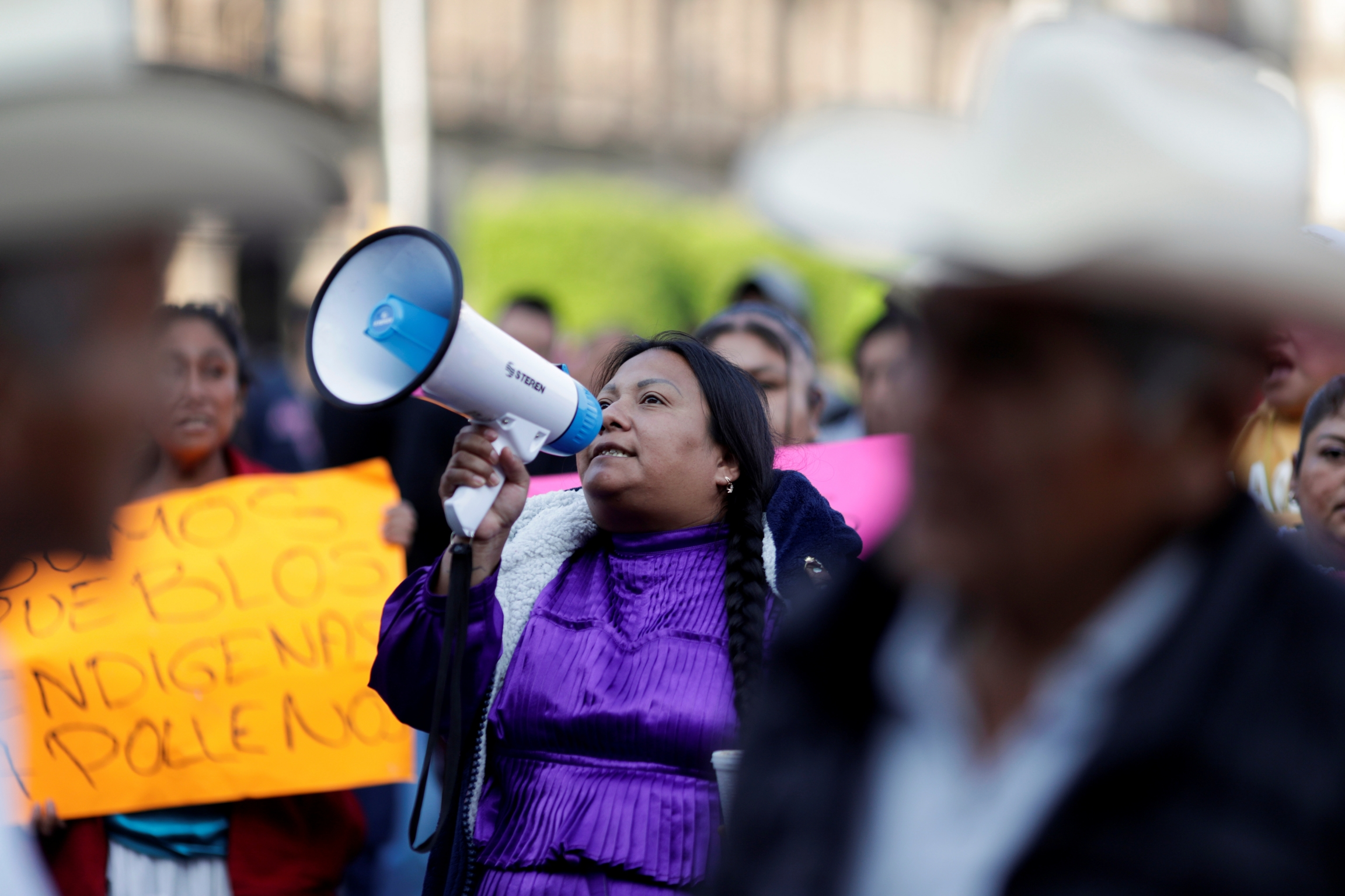 Oaxaca's artisans take part in a protest outside the National Palace to demand the federal government help for the loss of jobs and decrease in their labor services, after the Mexican government declared a health emergency and issued stricter regulations