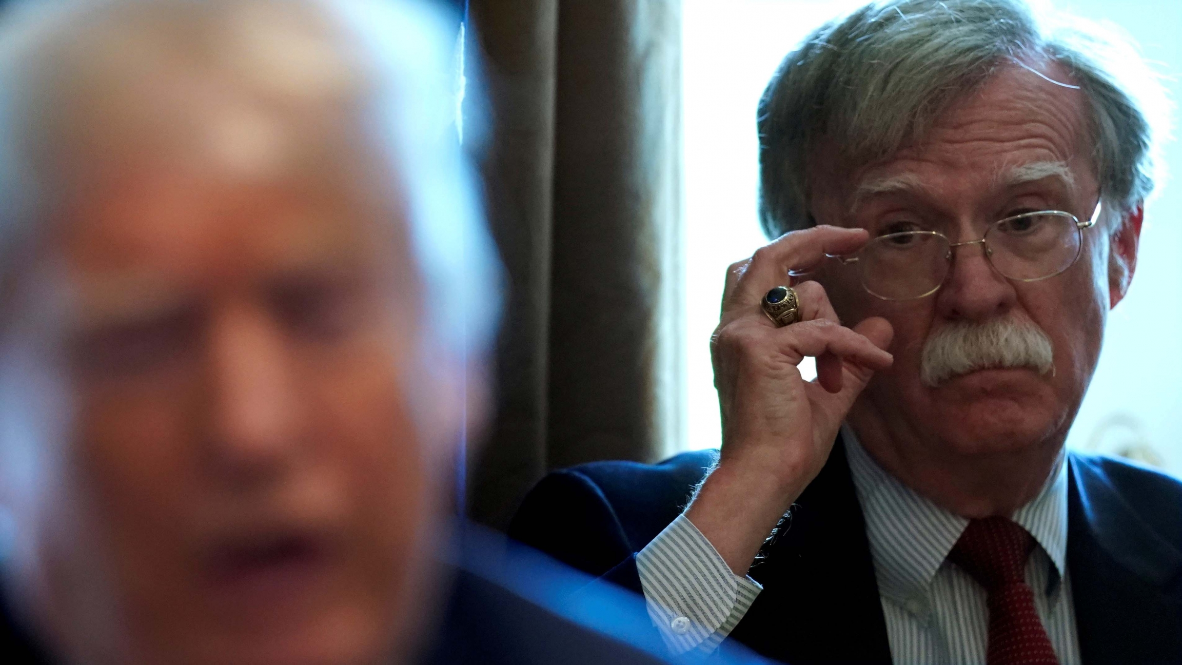 Then-National Security Adviser John Bolton listens as US President Donald Trump holds a Cabinet meeting at the White House in Washington, DC, on April 9, 2018.