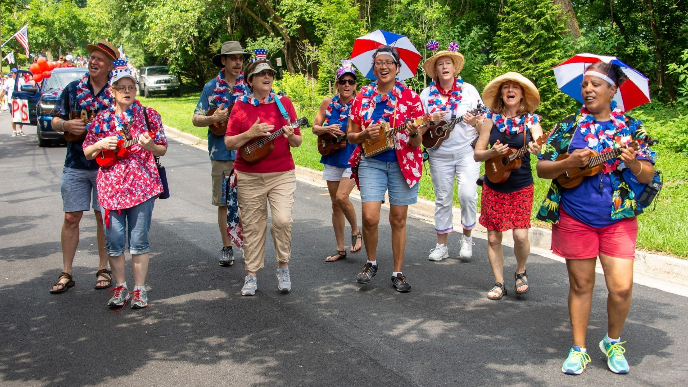 A Maryland-based ukulele marching band performs during a 2019 Fourth of July parade.