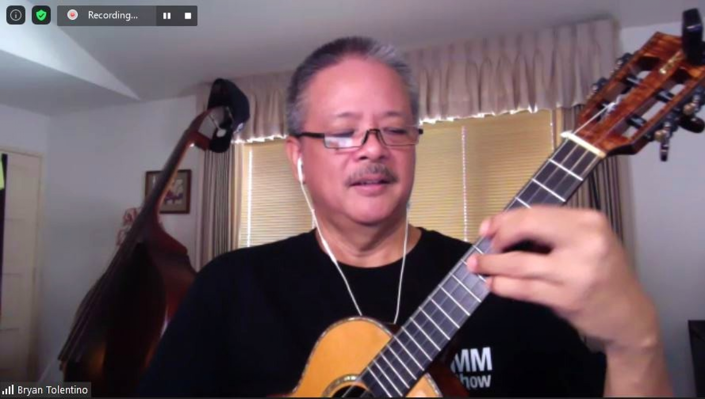 "A Zoom screenshot of ukulele teacher Brian Tolentino playing ""Somewhere Over the Rainbow."""