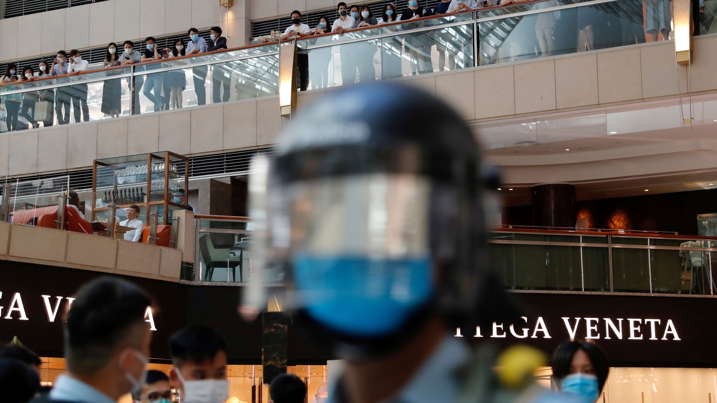 Riot police patrol at a shopping mall during a protest after China's parliament passes a national security law for Hong Kong, in Hong Kong, June 30, 2020.