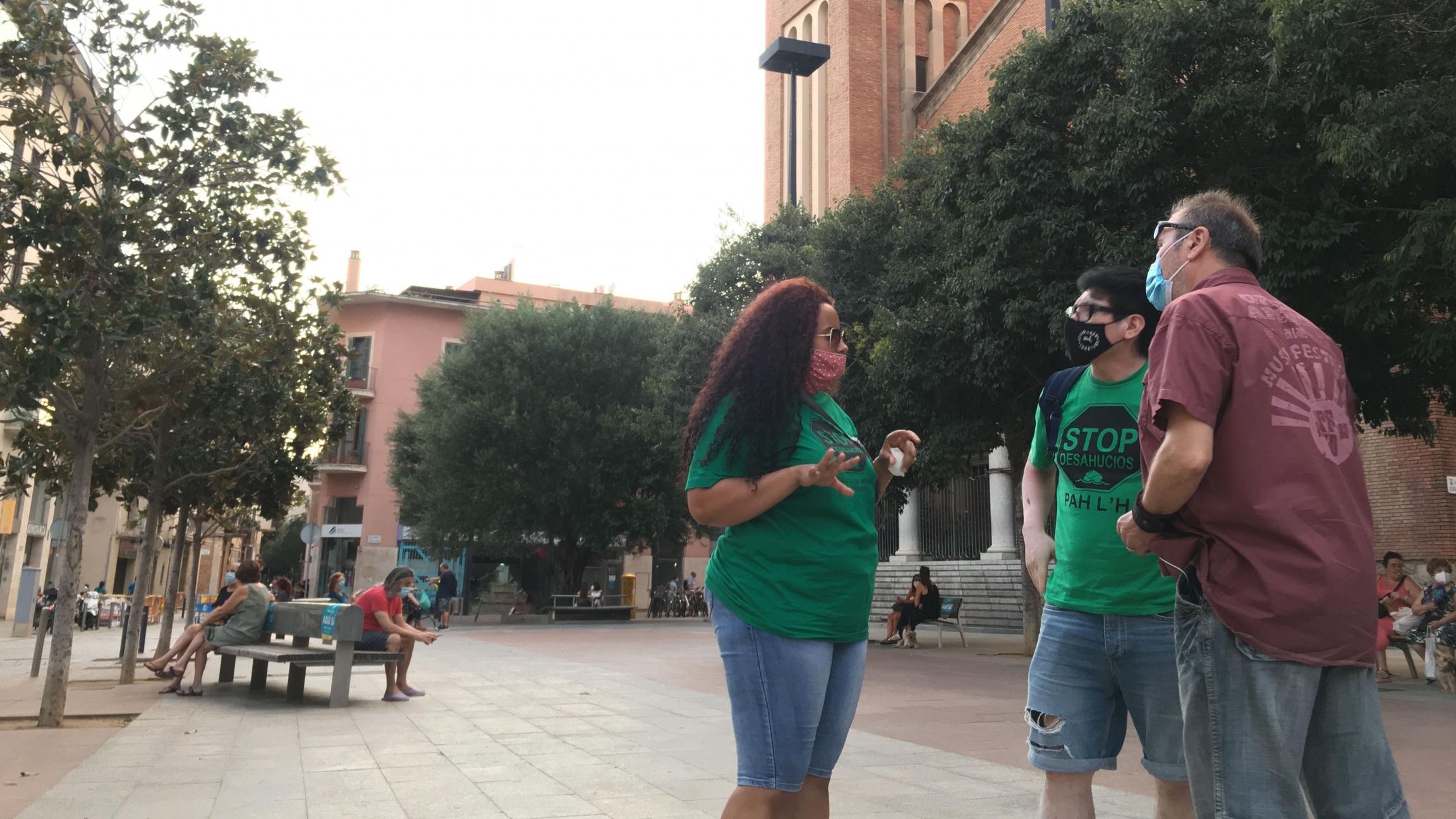 Marly Estrella is pictured with activists Luis Enrique Rumaldo (left) andManuel Rico inL'Hospitalet de Llobregat near Barcelona.