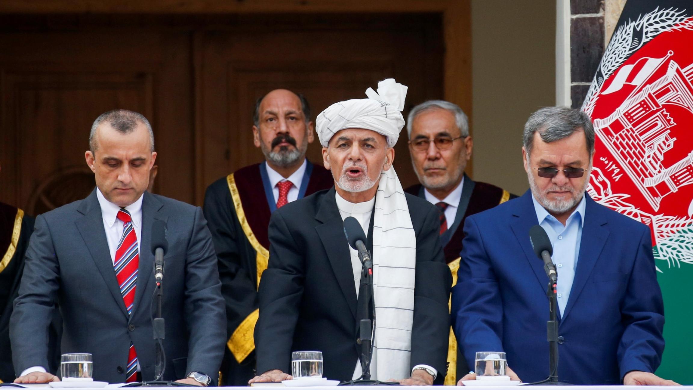 Afghanistan'sPresidentAshraf Ghani, center, his firstVicePresidentAmrullahSaleh, left, and secondVicePresidentSarwar Danish, right, taketheoath of office during their inauguration, in Kabul, Afghanistan, March 9, 2020.