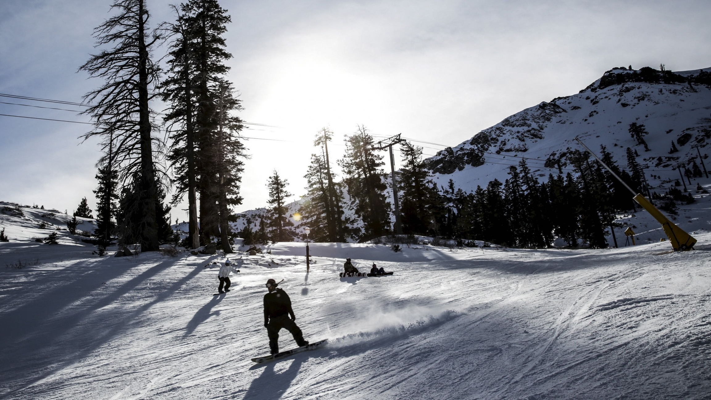 A snowboarder heads back to the lodge at Squaw Valley in Olympic Valley, California, Dec. 5, 2015. Last month, the resort announced plans to change its name in the coming year.
