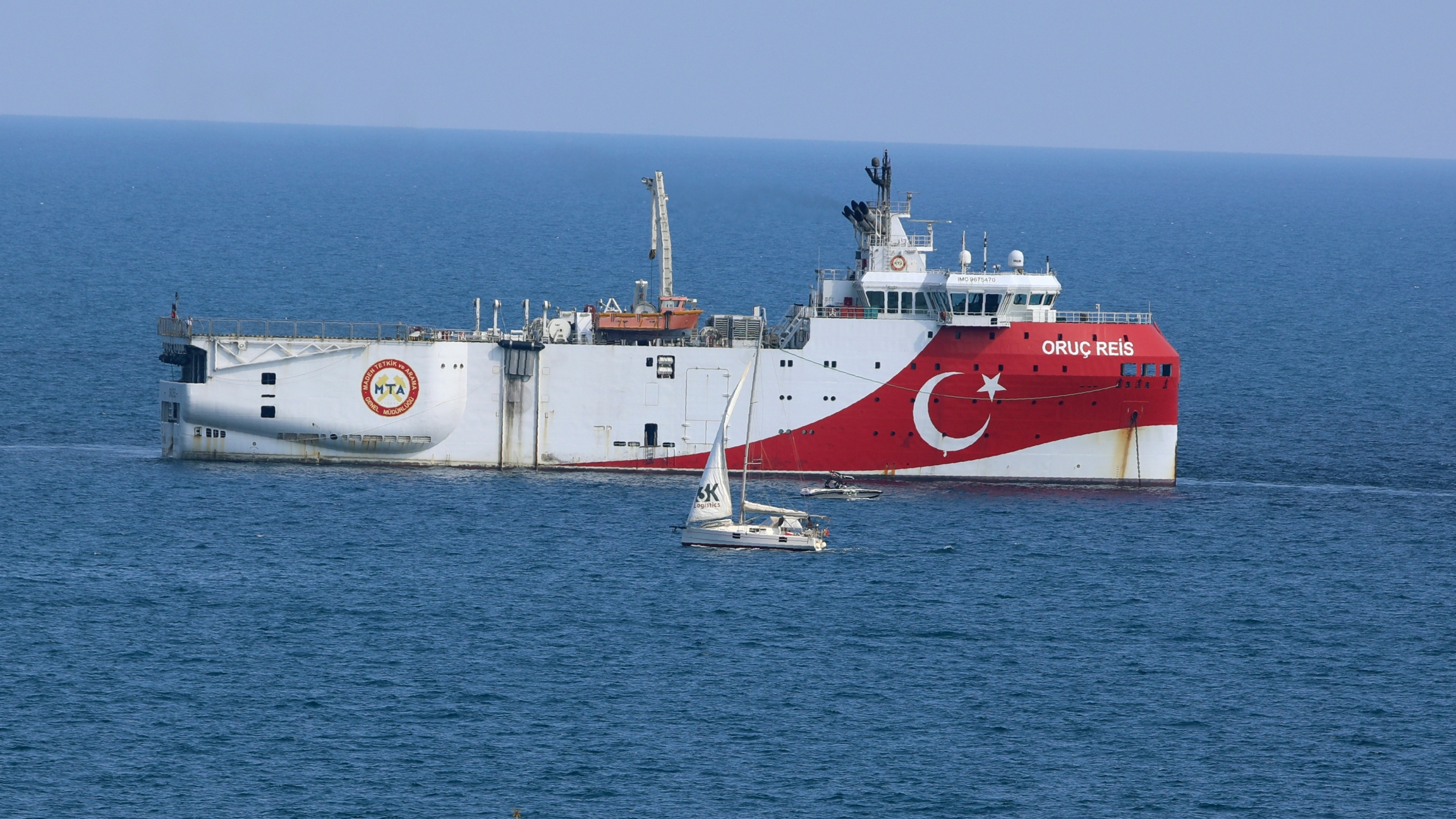 A Turkish ship with a flag sails in the eastern Mediterranean Sea