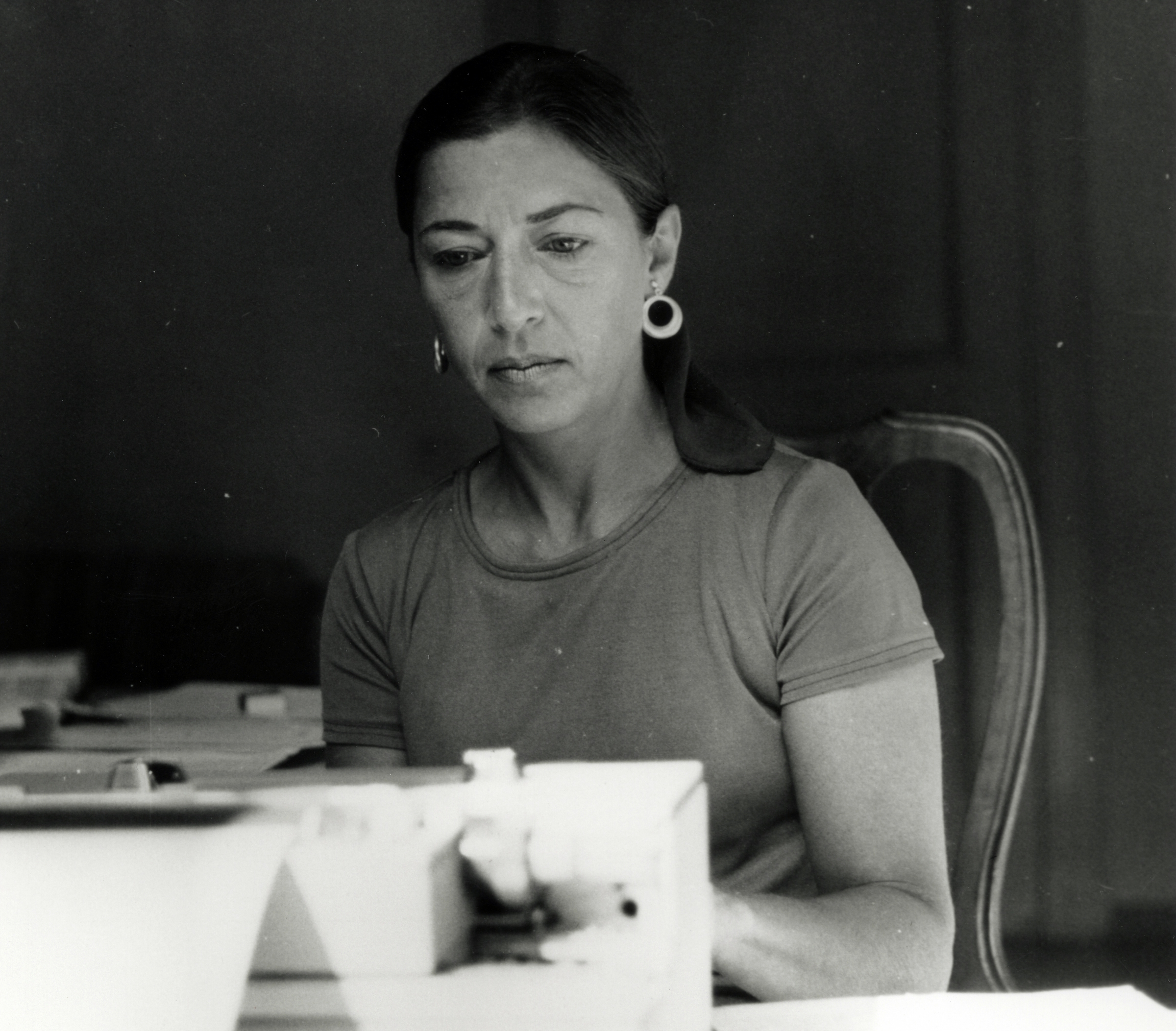 Black and white photo of young Ruth Bader Ginsburg wearing a casual shirt with her hair pulled back