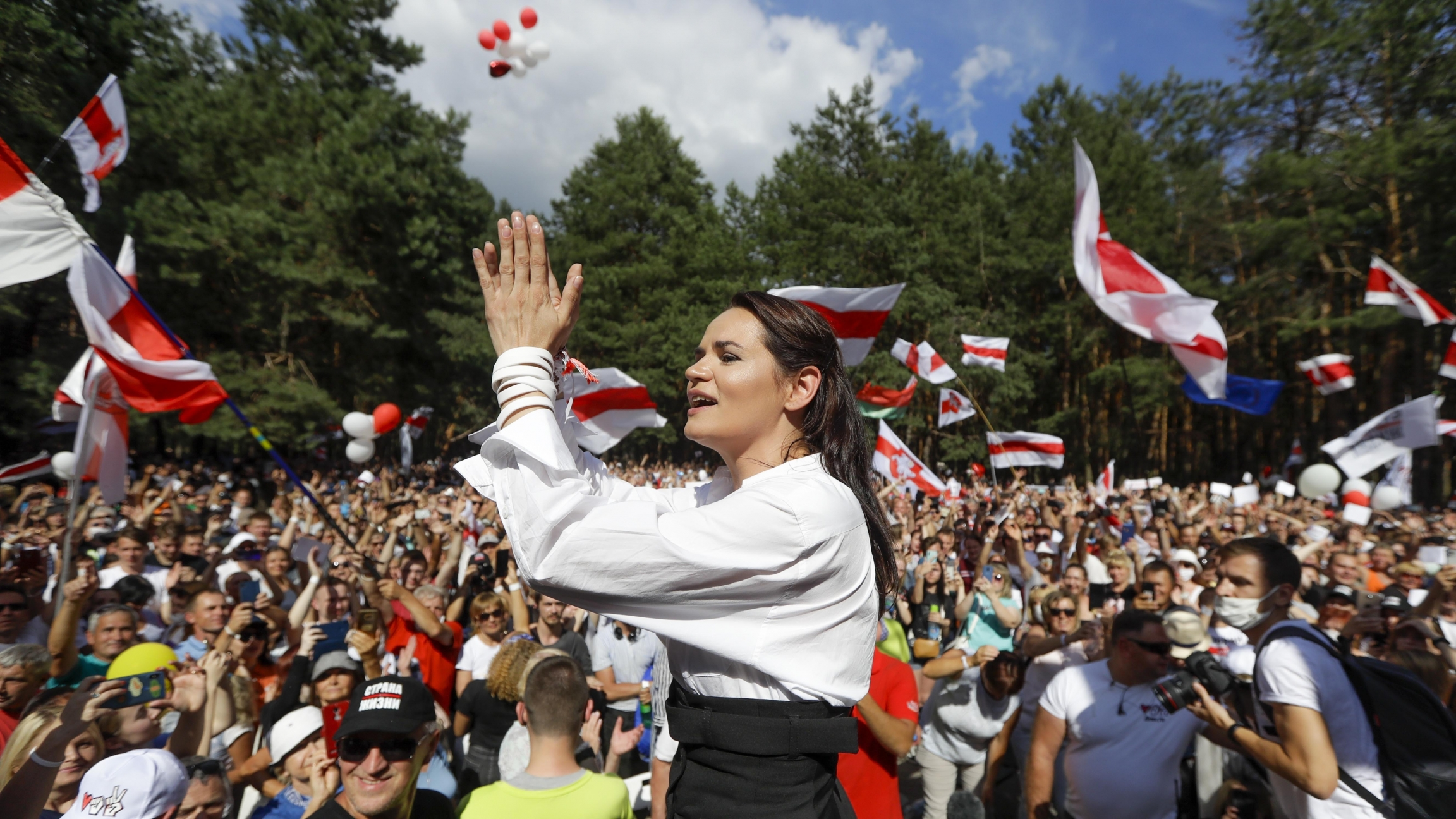 Svetlana Tikhanovskaya, a candidate for the presidential elections in Belarus, greets people during a meeting in her support in Brest, Belarus,Aug. 2, 2020.
