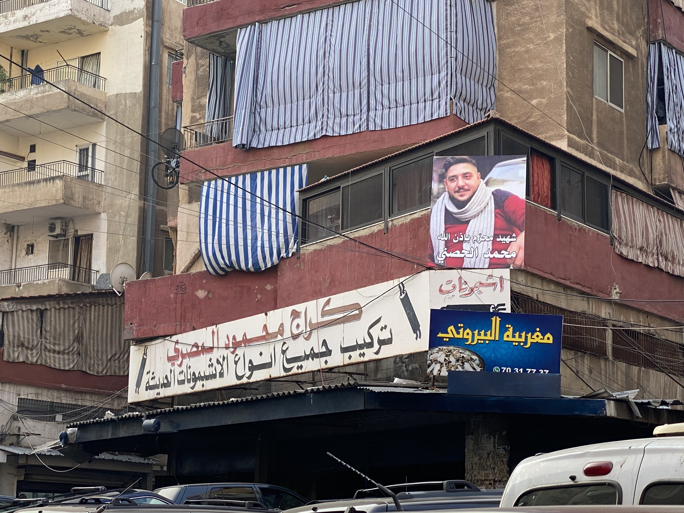 A picture of Mohammed Hosni hangs in the streets of his Tripoli neighborhood.