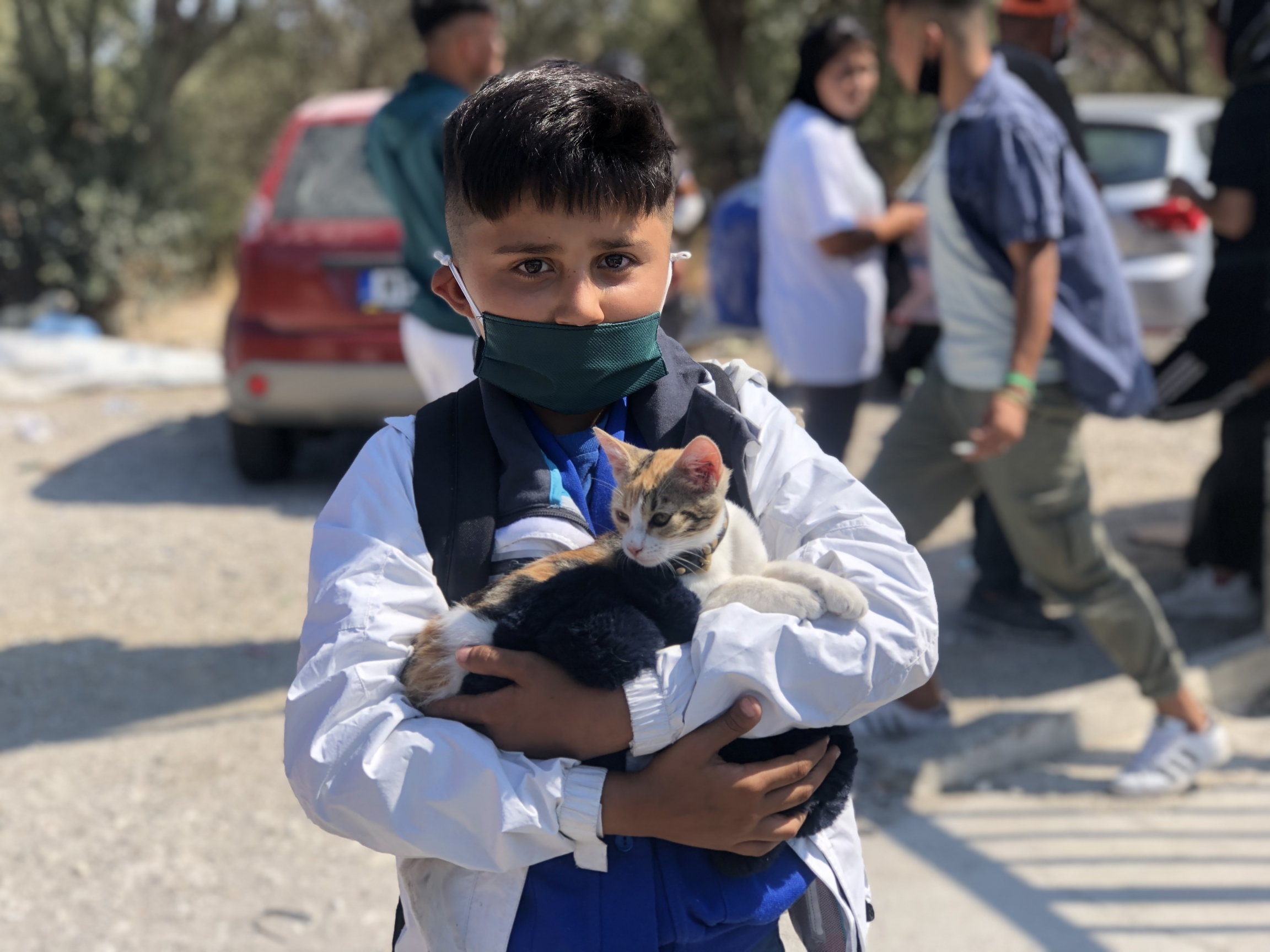 Mohammad, a young,Afghan asylum-seeker, found acat he named Kuchulu while at Moria. He worrieshe won'tbe able to bring his feline friend into the new camp.