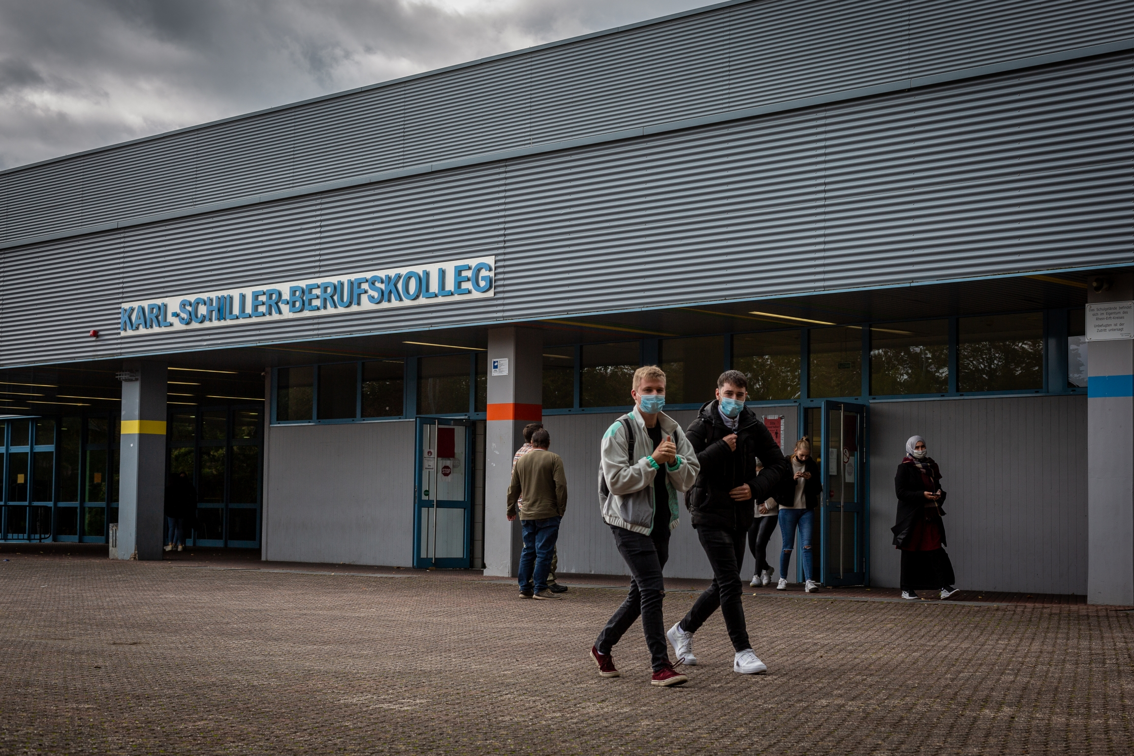 Students leave Karl-Schiller-Berufskolleg in Brühl, a  secondary school outside of Cologne, Germany. Students are required by the school to wear masks on schools grounds.