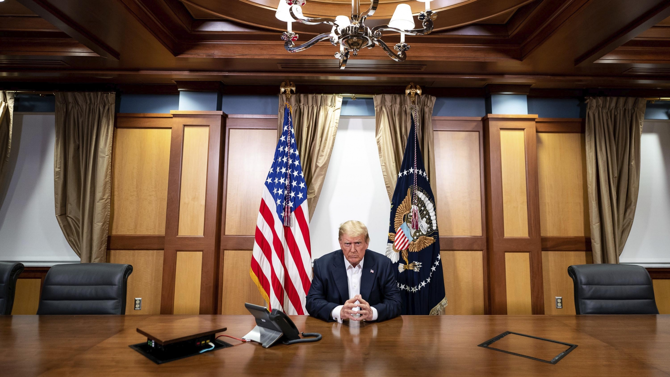President Donald Trump listens during a phone call Oct. 4, 2020, in his conference room at Walter Reed National Military Medical Center in Bethesda, Maryland.