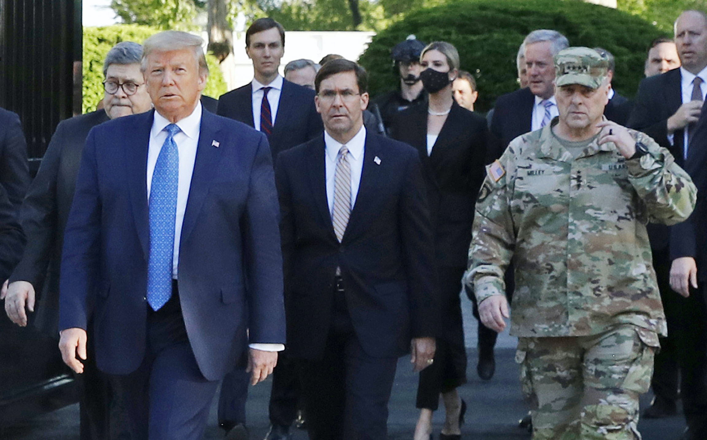 In this June 1 file photo, President Donald Trump departs the White House to visit outside St. John's Church. Walking behind Trump, at right, is Gen. Mark Milley, chairman of the Joint Chiefs of Staff.