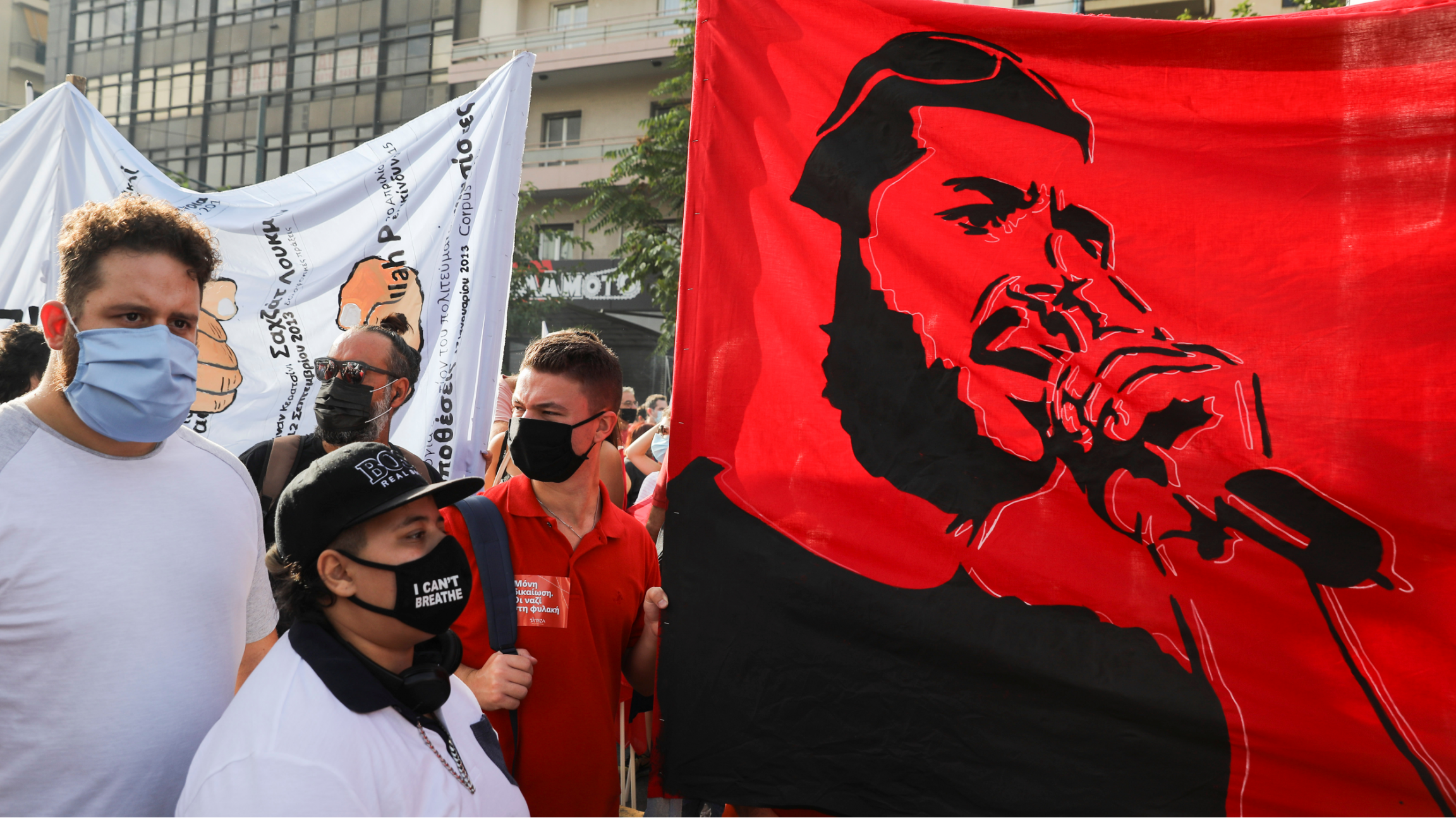A bright red banner depicting anti-racist Greek rapper Pavlos Fyssas is seen, as demonstrators protest at the close of the trial for leaders and members of the far-right Golden Dawn, in Athens, Greece, Oct. 7, 2020.