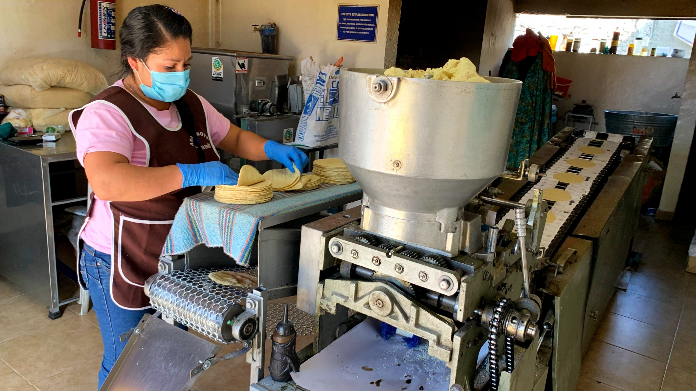 Marta Hernandez stacks tortillas coming out of the oven at La Abuela.