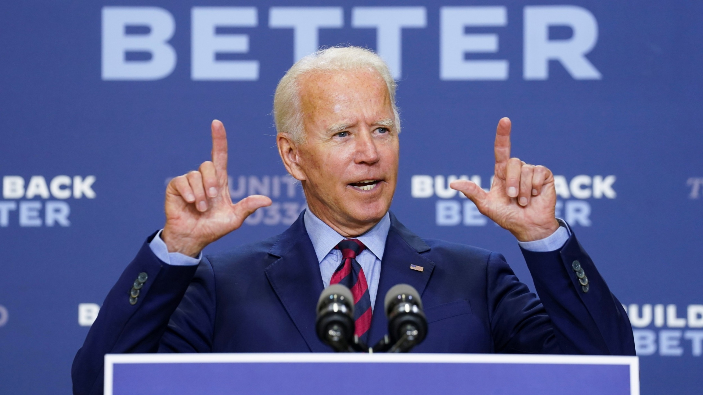 Democratic US presidential nominee and former Vice President Joe Biden answers questions from reporters after a speech about the effects on the economy of the Trump administration's response to the coronavirus during an appearance in Wilmington, Del., Sep