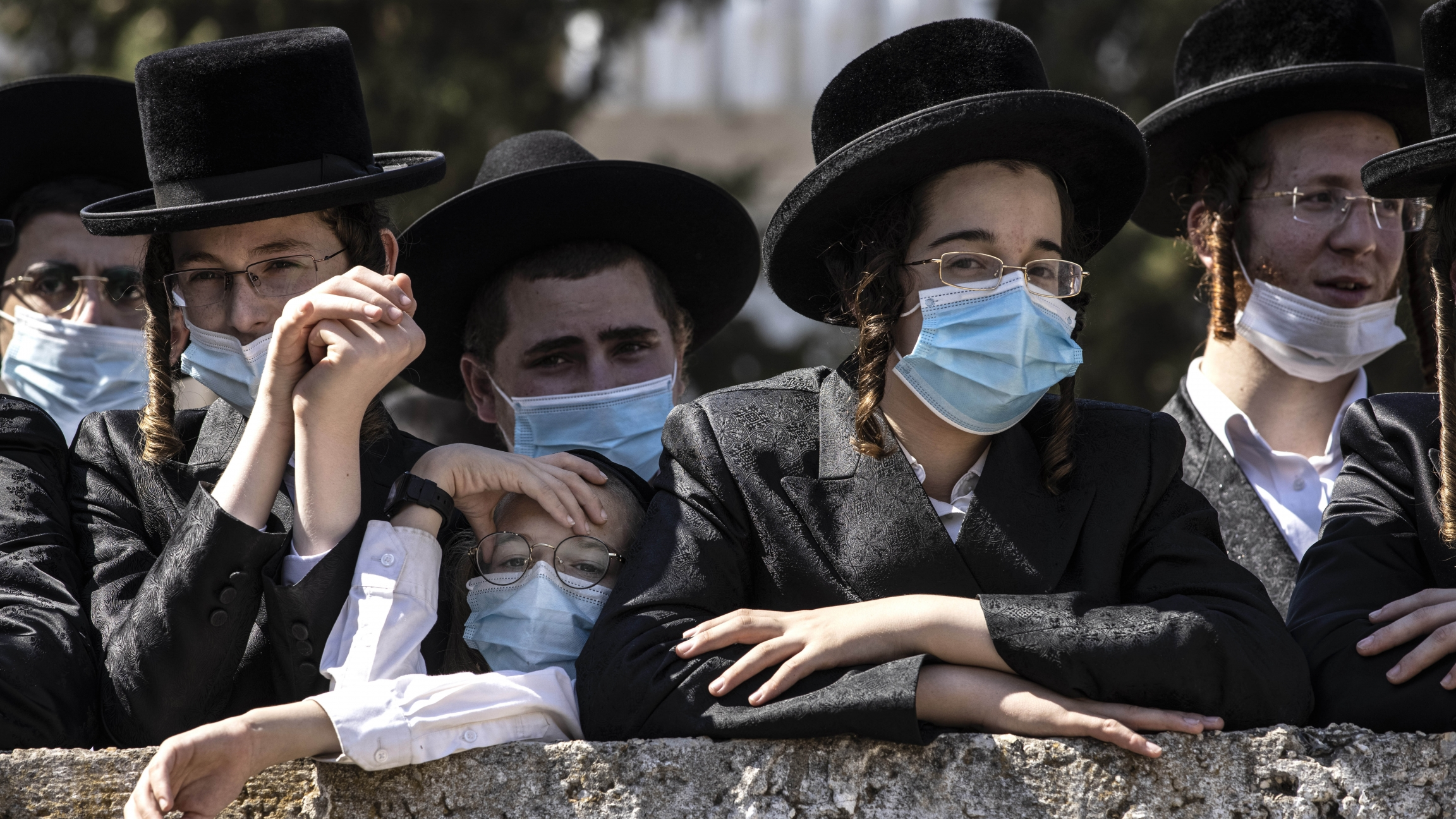 Ultra-Orthodox Jewish teens attend the funeral for Rabbi Mordechai Leifer in Ashdod, Israel, Oct. 5, 2020.