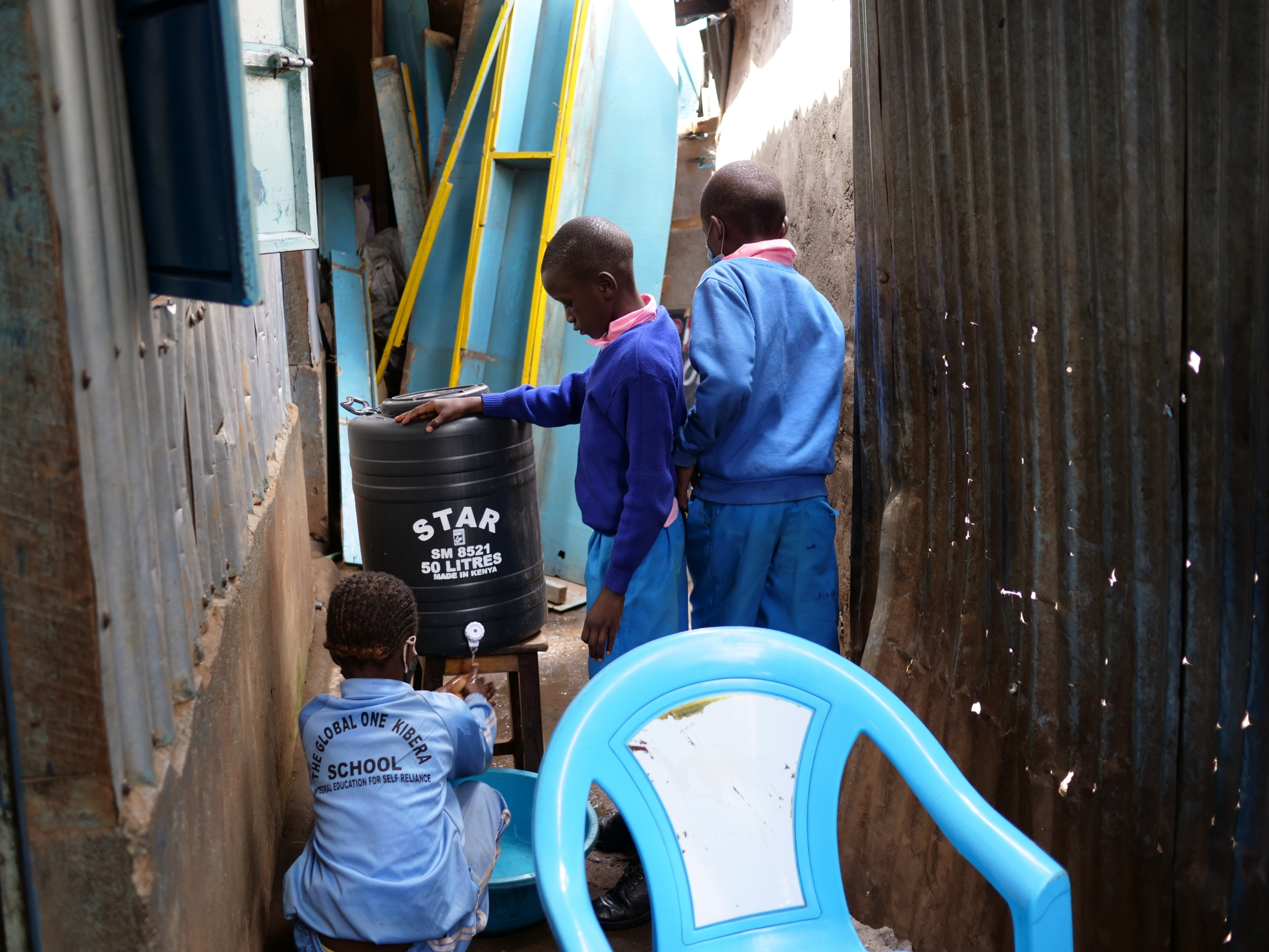 Primary school students wash their hands before a snack break at the Global One School in Nairobi, Kenya.