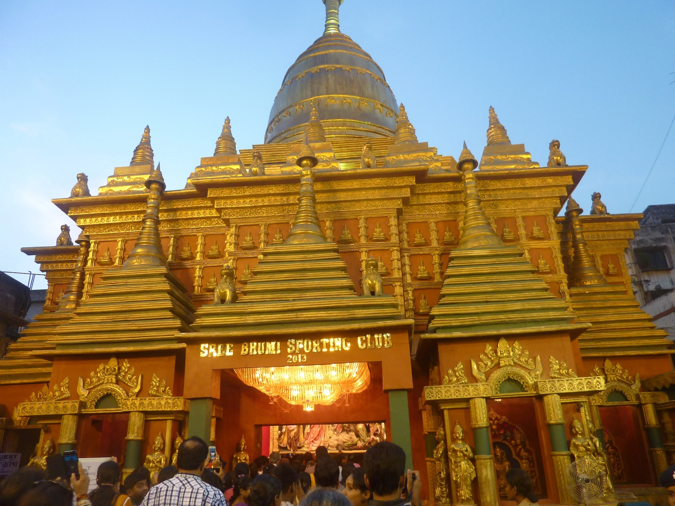 An ornate structure with golden tipped points in the shape of a Thai-style temple.