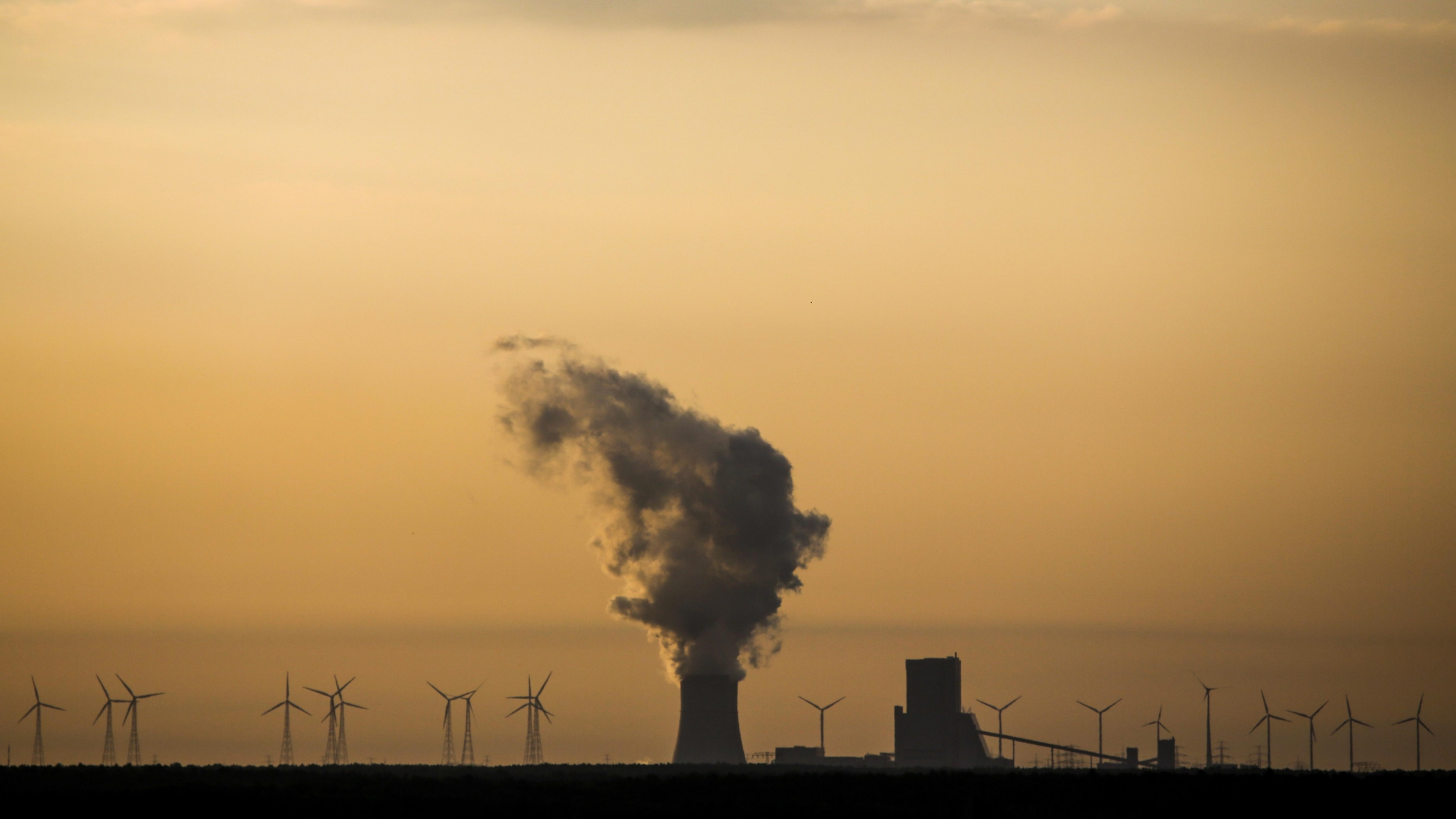 In this June 5, 2018 file photo, steam rises in the air from the brown coal power plant Schwarze Pumpe in the Lusatia area in Germany.