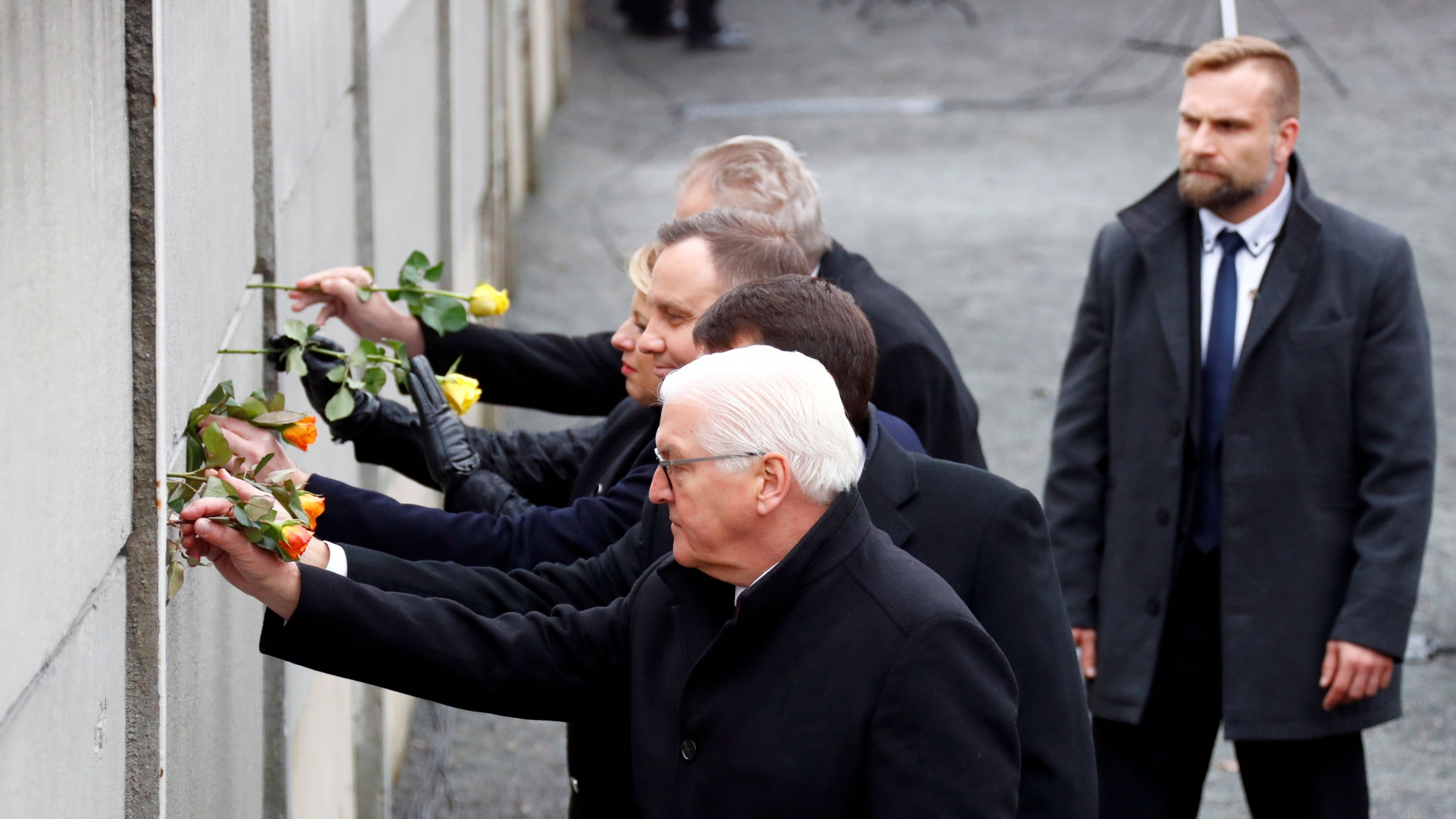 German President Frank-Walter Steinmeier, Hungary's President Janos Ader, Poland's President Andrzej Duda, Slovakia's President Zuzana Caputova and Czech Republic's President Milos Zeman place roses into a gap at the Wall memorial during a ceremony markin