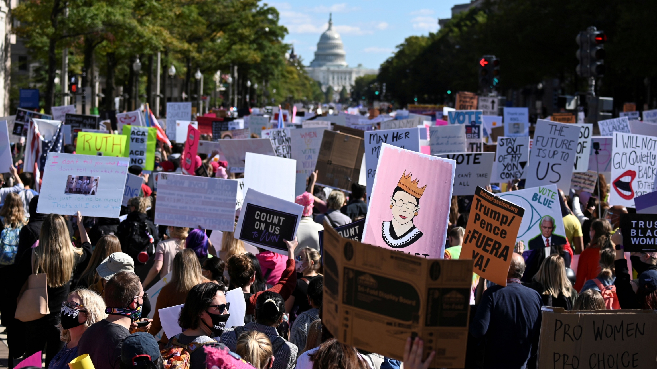 Women's March activists participate in a nationwide protest against US President Donald Trump's decision to fill the seat on the Supreme Court left by the passing of late Justice Ruth Bader Ginsburg before the 2020 election, in Washington,Oct.17, 2020.