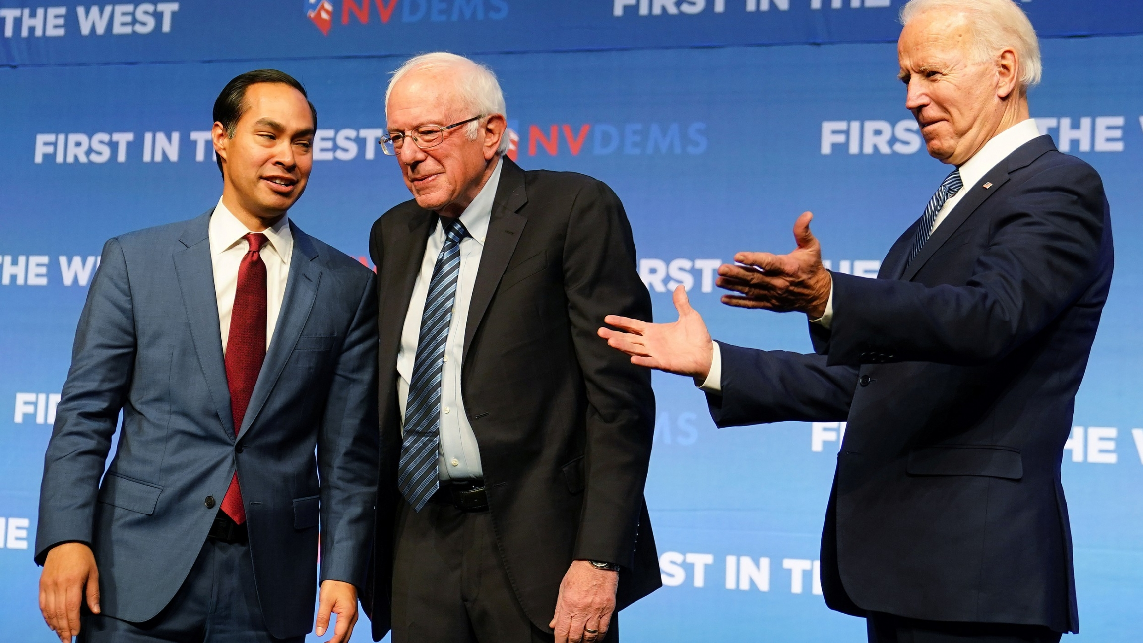 In this file photo, Democratic US presidential candidates Julian Castro, Bernie Sanders and Joe Biden are pictured on stage at a First in the West Event at the Bellagio Hotel in Las Vegas, Nevada, Nov. 17, 2019.