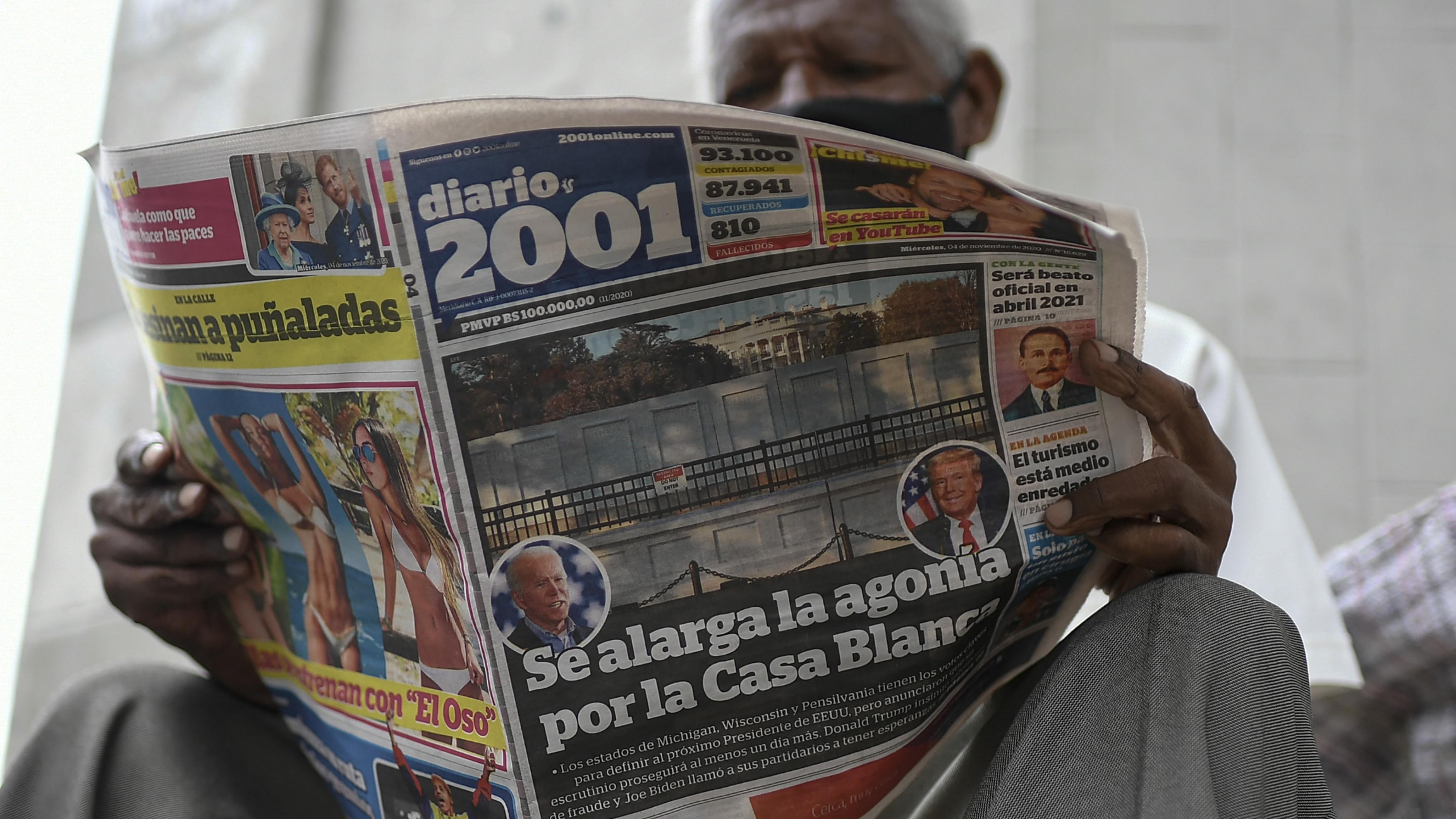 "A man reads the Diario 2001 newspaper that carries the Spanish headline: ""Agony is prolonged for the White House"" at a newspaper stand in Caracas, Venezuela, Nov. 4, 2020, the day after US elections."