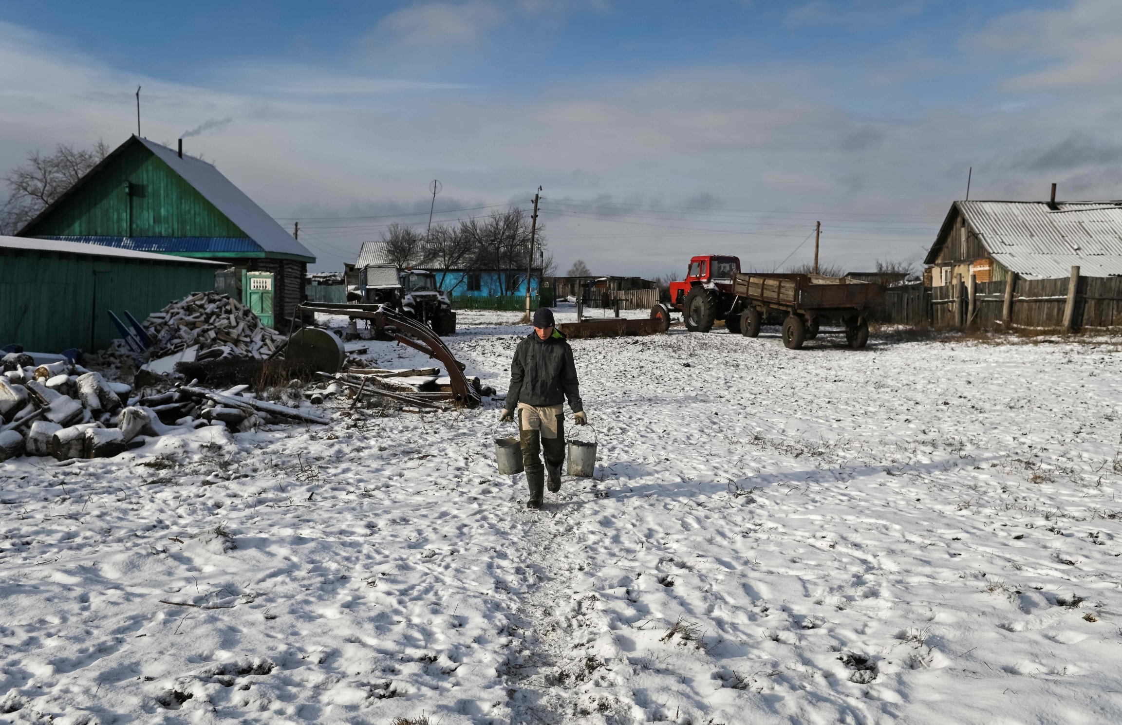 Student Alexei Dudoladov, 21, also works on his family's farm.