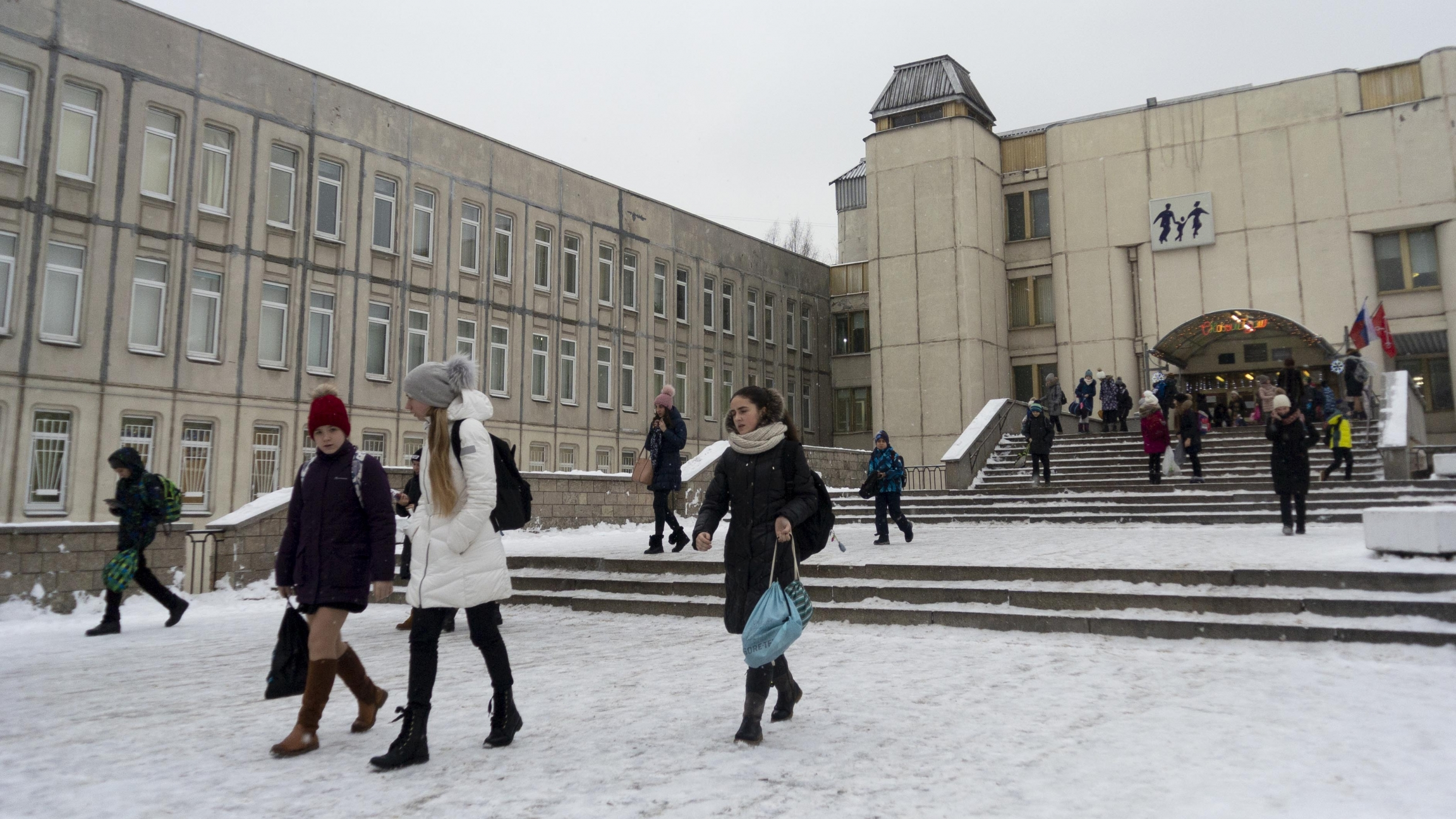 In this photo taken on Thursday, Dec. 20, 2018, students come out of a school building in St. Petersburg, Russia.