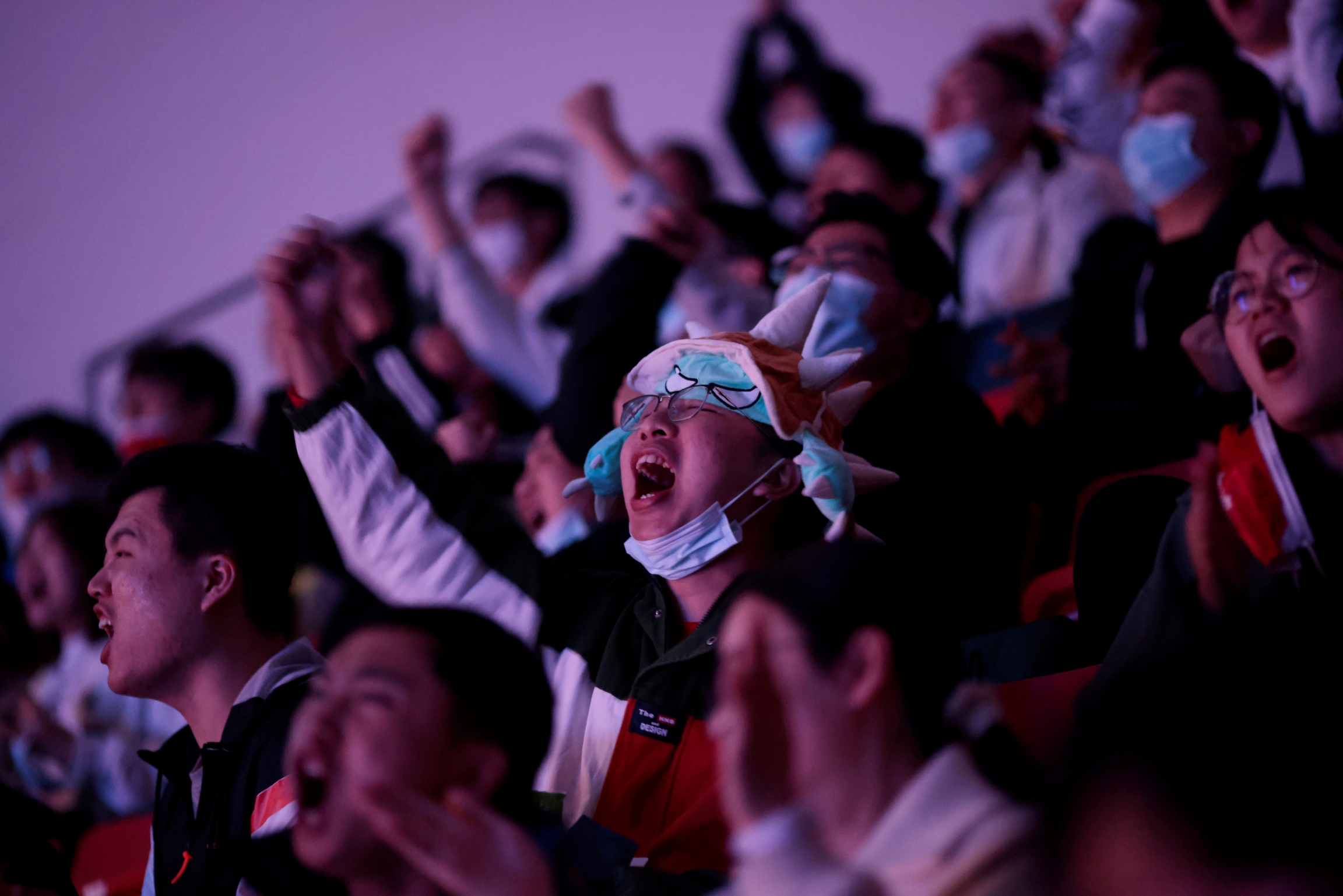 Fans react at the League of Legends (LOL) World Championship Finals, in Shanghai.