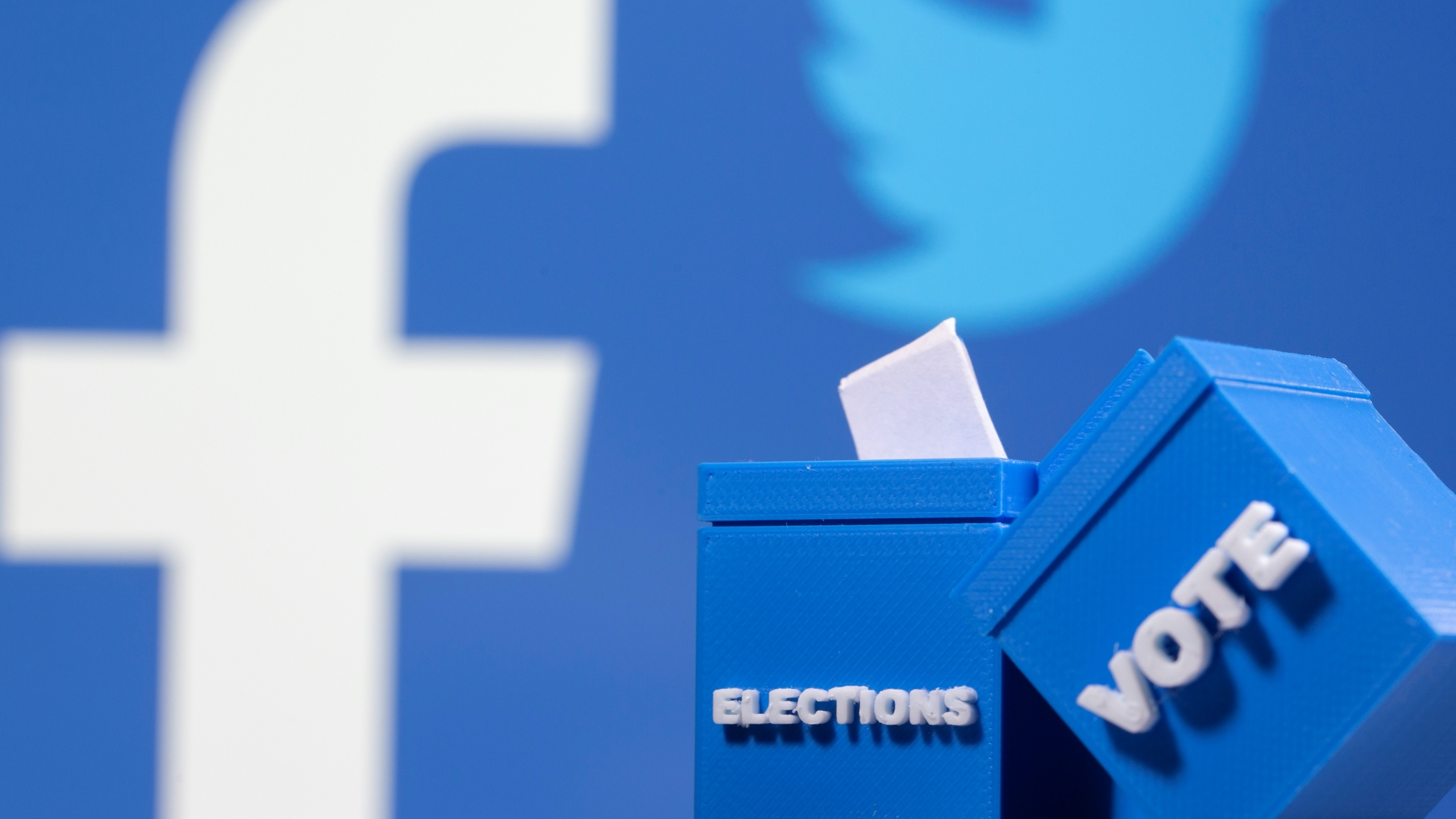 "Blue background with Facebook and Twitter logo and two blue boxes with ""election"" and ""vote"" written on it in white letters"