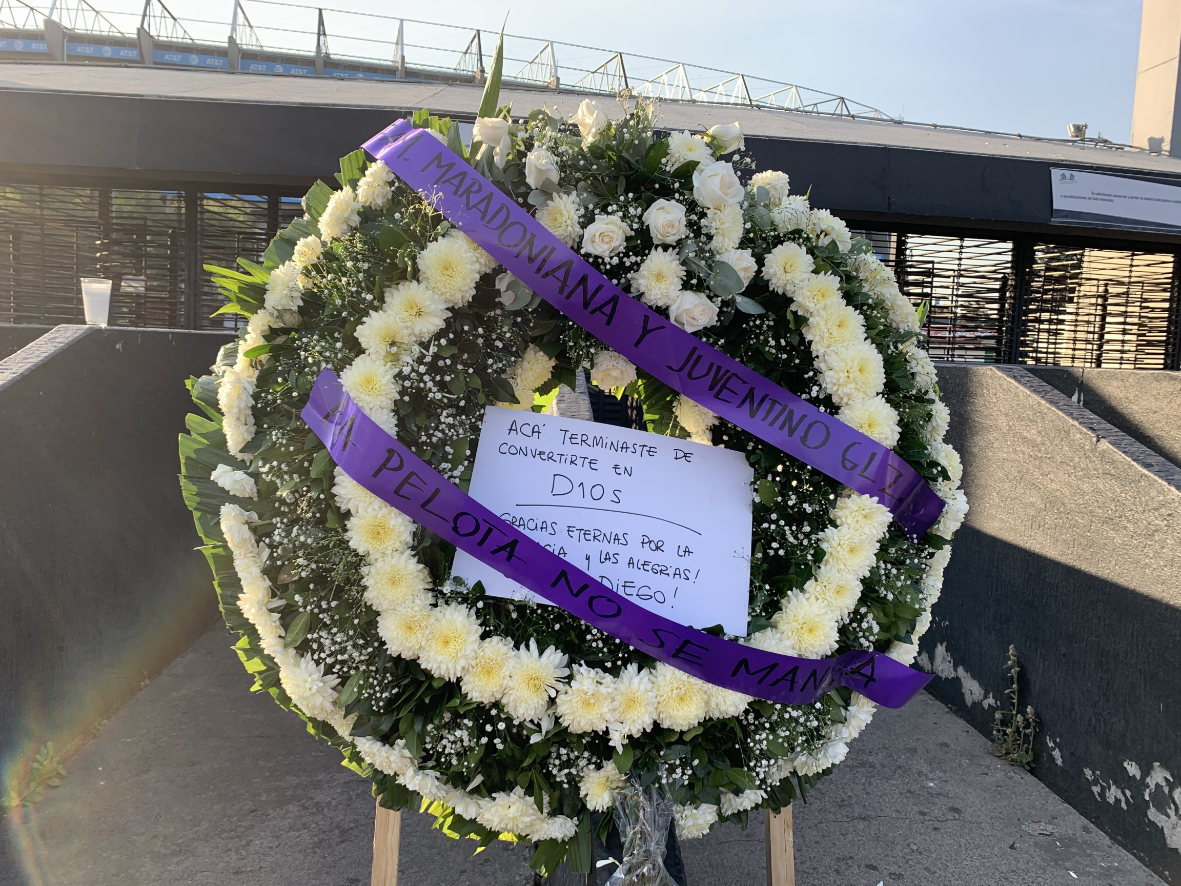 """A wreath for Diego Maradona reading, """"This is where you became God"""" sits outside Estadio Azteca, the stadium where Maradona led Argentina to defeat England in the 1986 World Cup, in Mexico City, Mexico, Nov. 26, 2020."""