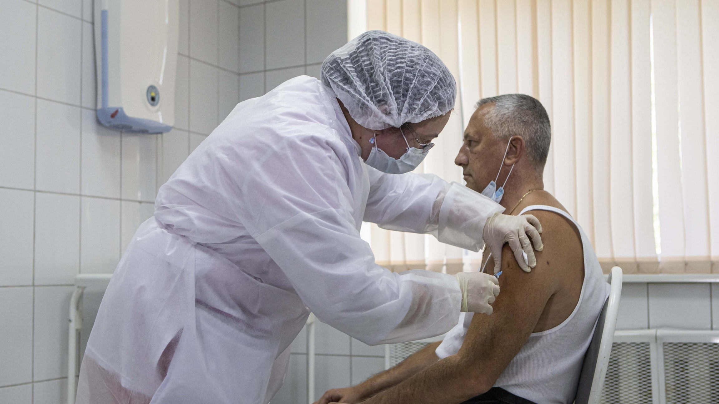 In this Sept. 15, 2020, file photo, a Russian medical worker administers a shot of Russia's experimental Sputnik V coronavirus vaccine in Moscow, Russia.
