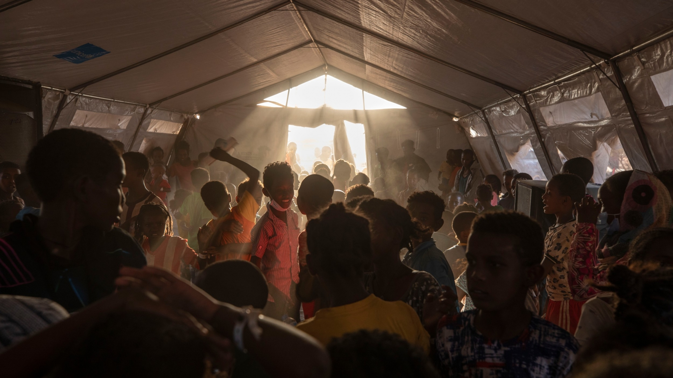 Tigray refugee children sing and dance inside a tent run by UNICEF for children's activities, in Umm Rakouba refugee camp in Qadarif, eastern Sudan, Thursday, Dec. 10, 2020.