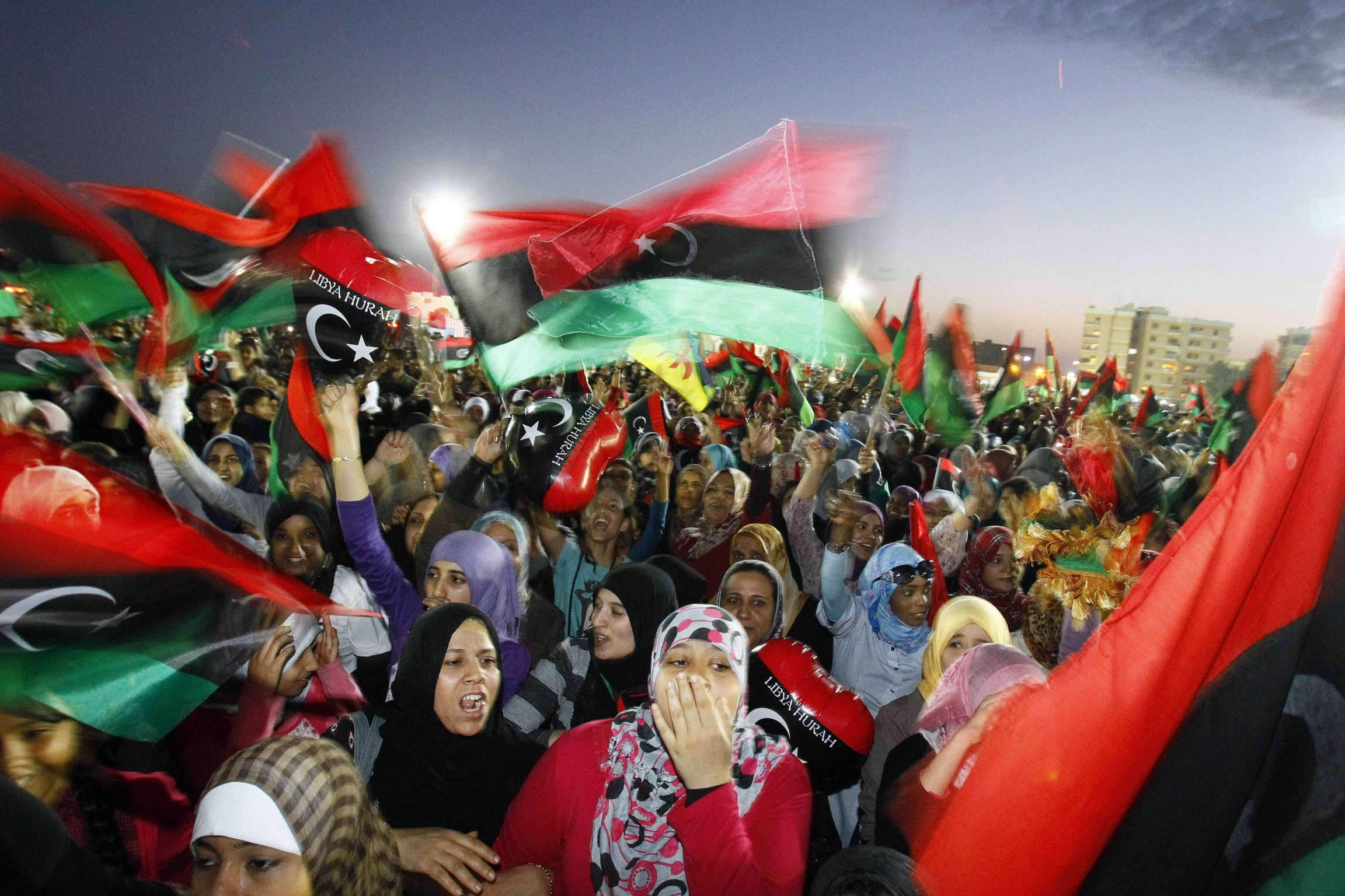 In this Sunday Oct. 23, 2011 file photo, Libyan celebrate at Saha Kish Square in Benghazi, Libya, as Libya's transitional government declares the official liberation of Libya after months of bloodshed that culminated in the death of longtime leader Moamma