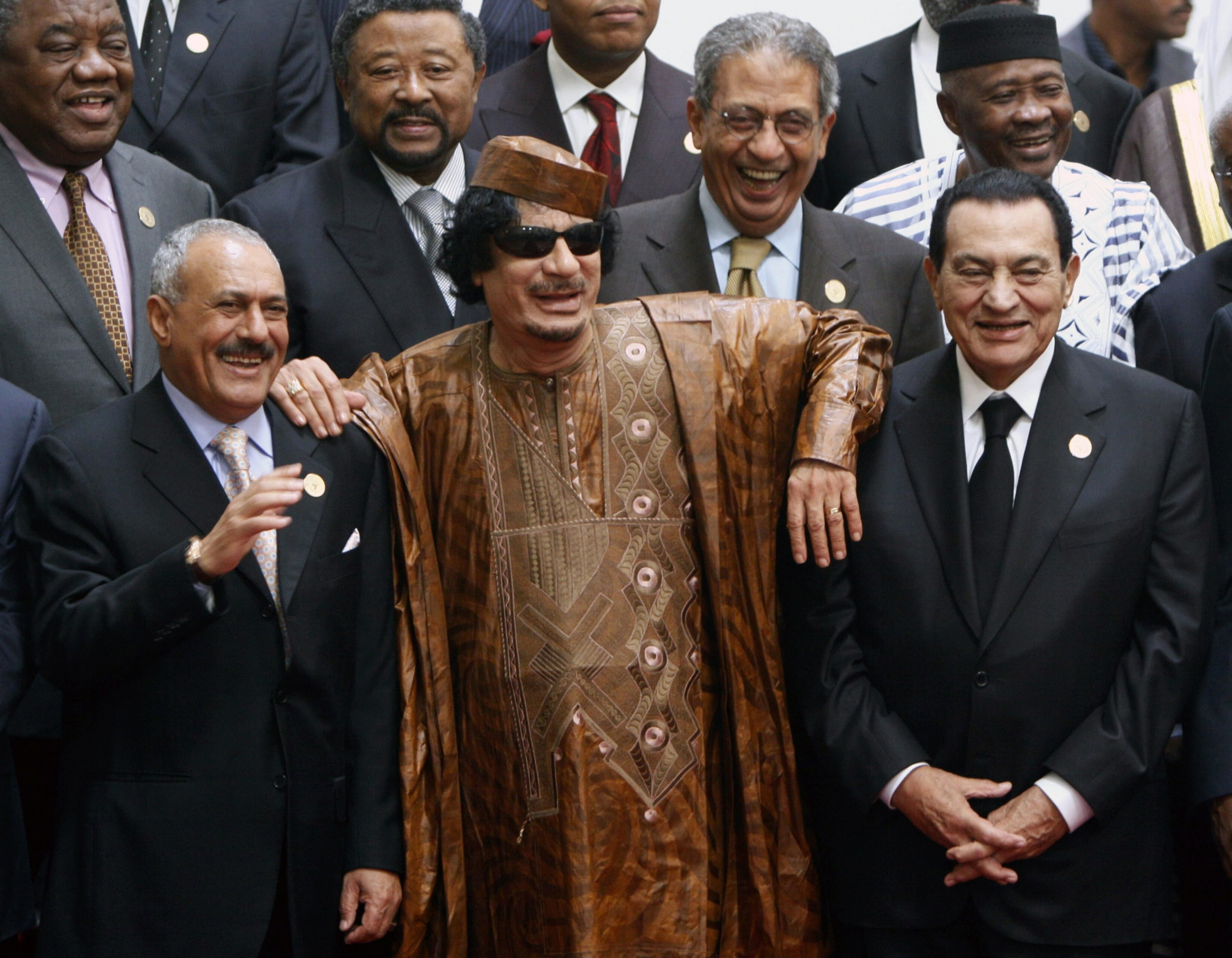 In this Oct. 10, 2010 file photo, Libyan leader Moammar Gadhafi, center, with Egyptian President Hosni Mubarak, right, and his Yemeni counterpart Ali Abdullah Saleh, left, pose during a group picture with Arab and African leaders during the second Afro-Ar