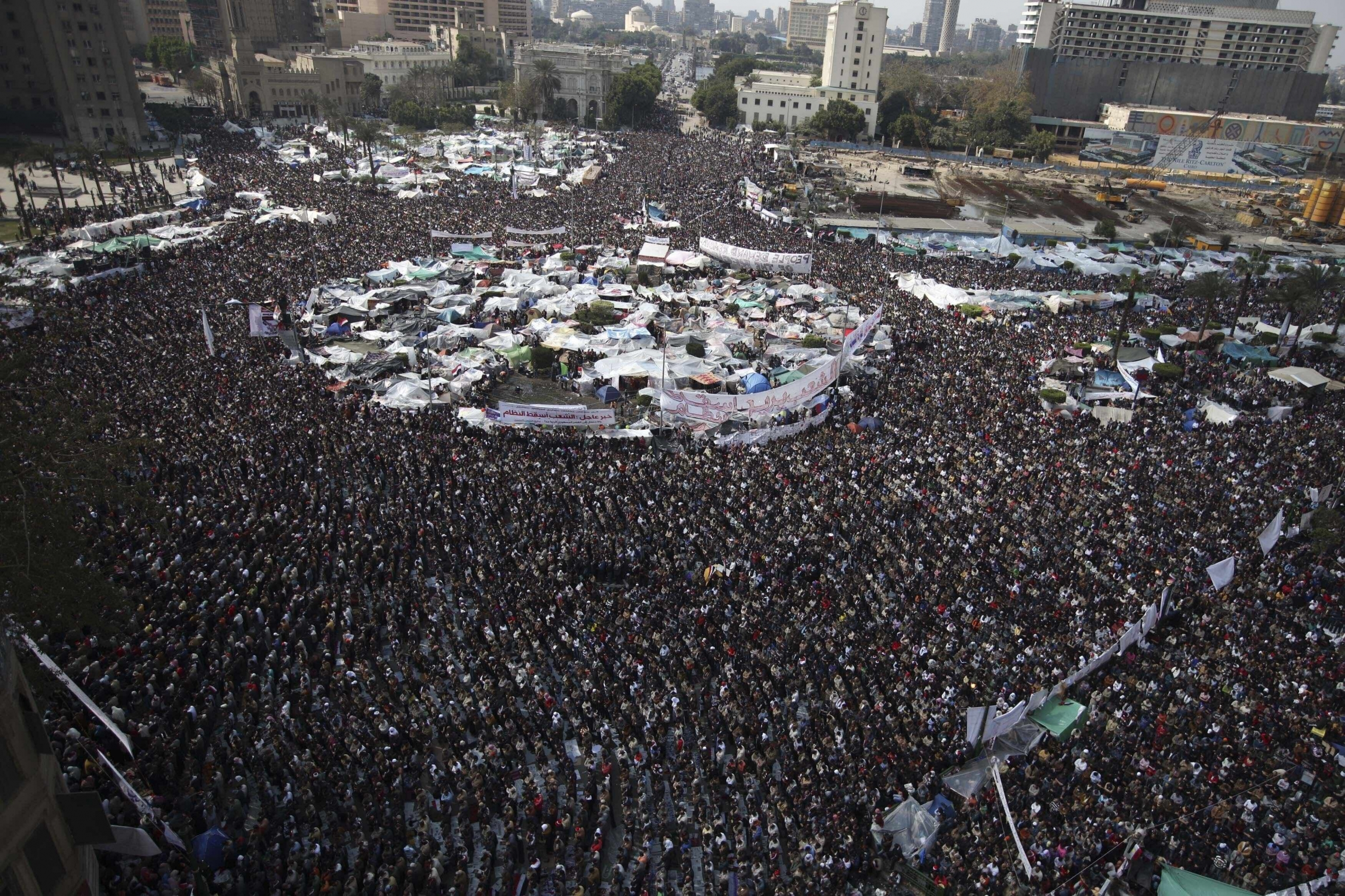 In this Feb. 11, 2011 file photo, anti-government protesters perform Friday prayers at the continuing demonstration in Tahrir Square, Cairo, Egypt.