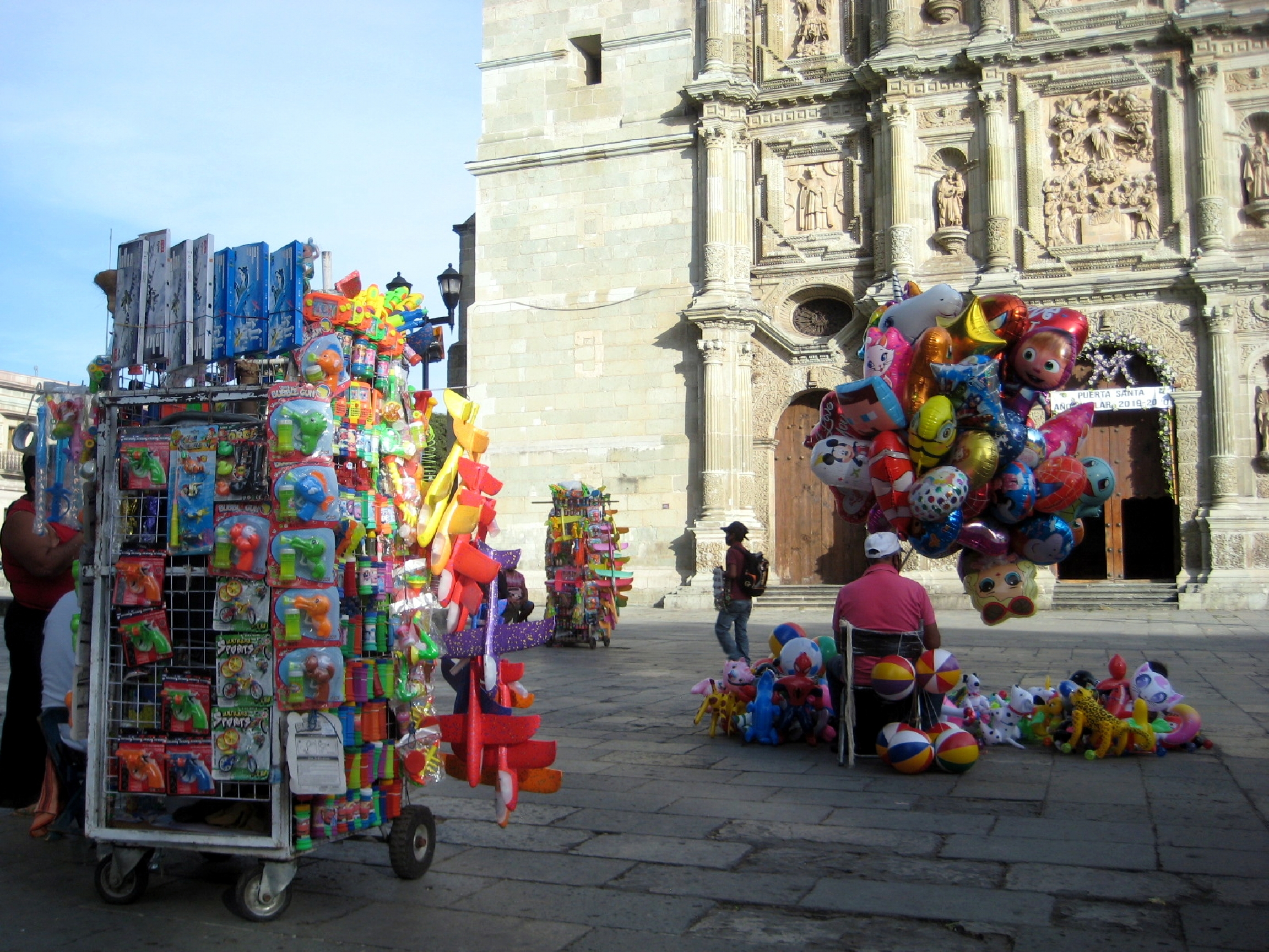Vendors in front of Oaxaca's landmark cathedral have been outnumbering potential clients these days.