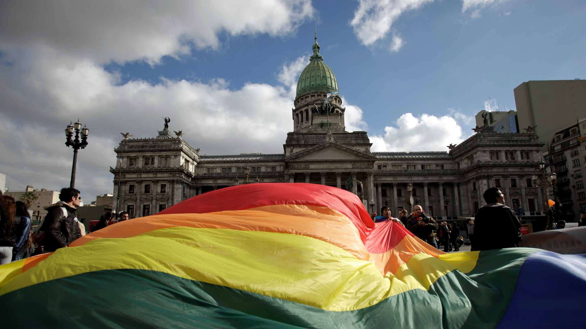 Demonstrators wave a large rainbow flag outside congress in support of a proposal to legalize same-sex marriage in Buenos Aires.