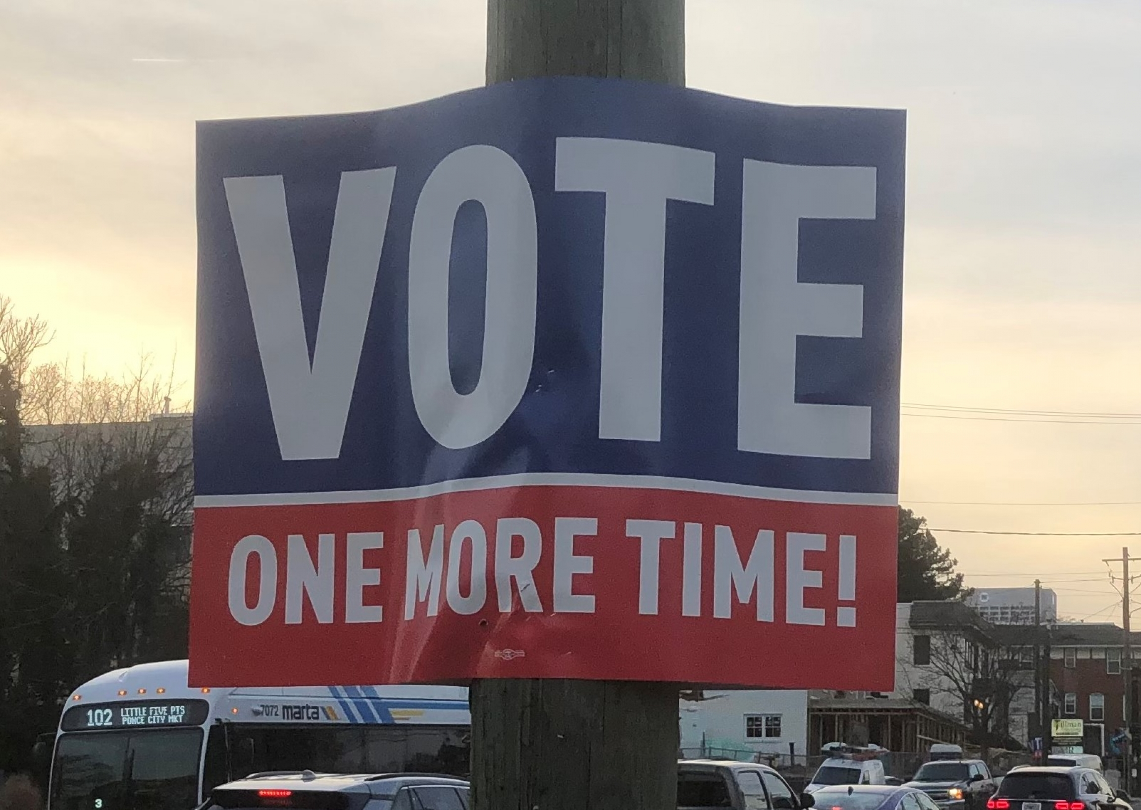 """""""Vote one more time"""" sign with blue, white and red letters."""