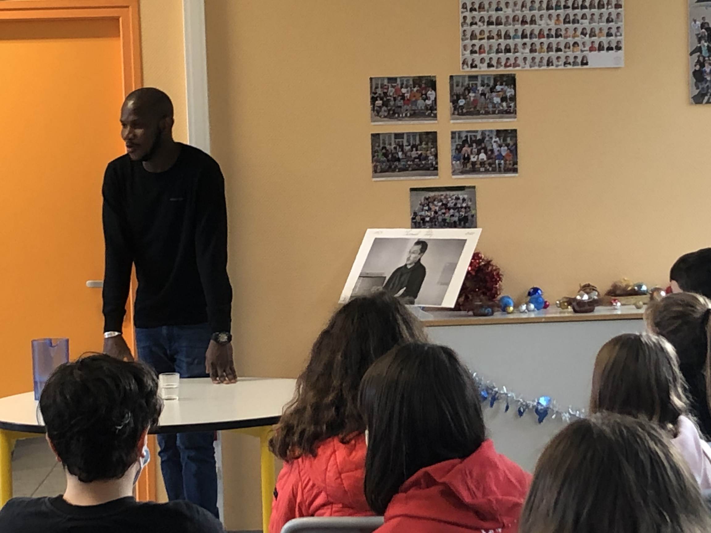 Lassana Bathily speaks to a group of students at Francois Charles Middle School in Plougasnou, France, Dec. 11, 2020.