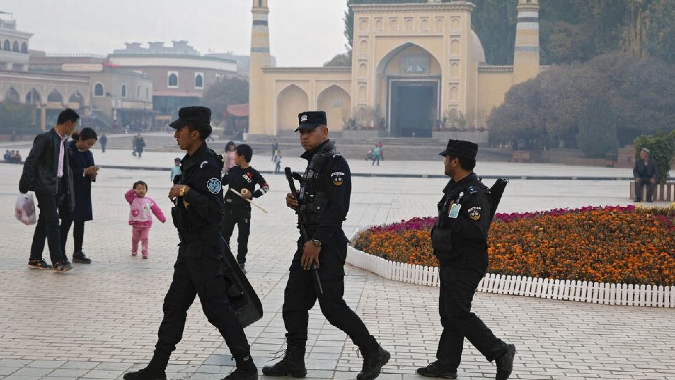 Uighur security personnel patrol near the Id Kah Mosque in Kashgar in western China's Xinjiang region,Nov. 4, 2017. A Chinese Communist Party official signaled Monday, Dec. 21, 2020, that there would likely be no let-up in its crackdown in the Xinjiang r