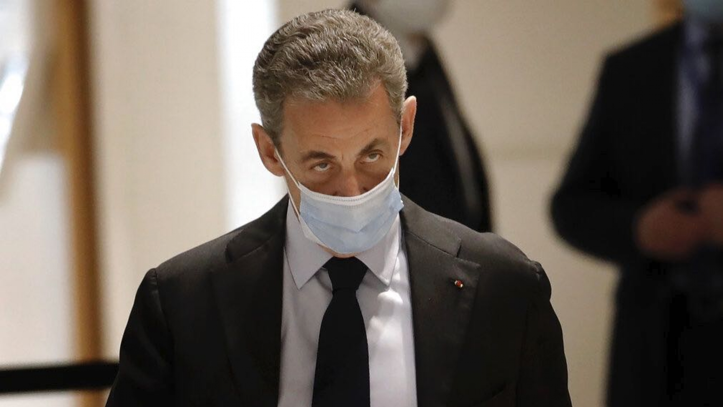 Former French President Nicolas Sarkozy arrives at the courtroom Monday, Nov. 30, 2020, in Paris.
